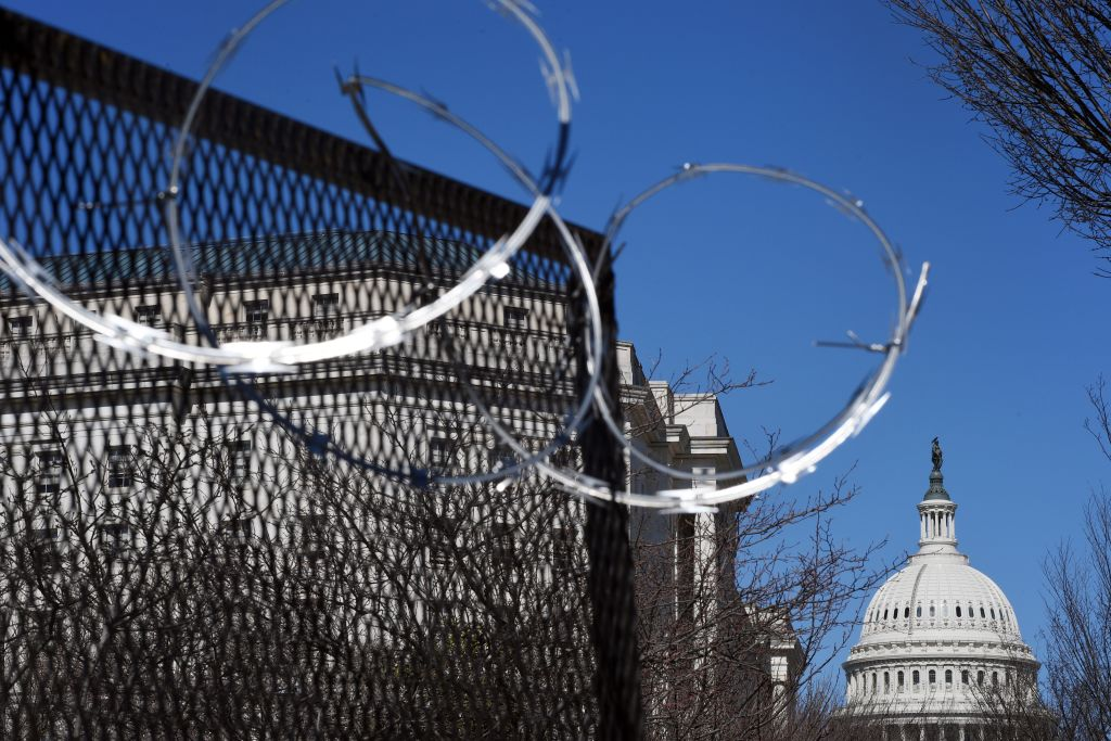 Razor wire is seen on fencing near the US Capitol Building on Capitol Hill in in Washington, D.C., on March 3, 2021.