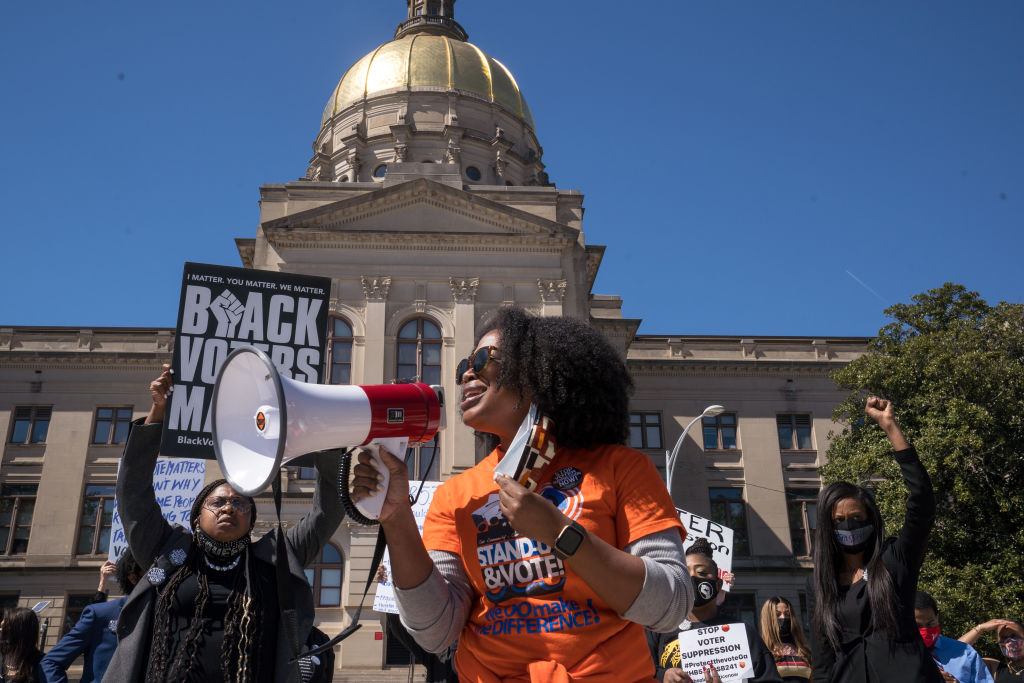 Demonstrators protest outside of the Capitol building in opposition of House Bill 531 in Atlanta, Georgia, on March 8, 2021.