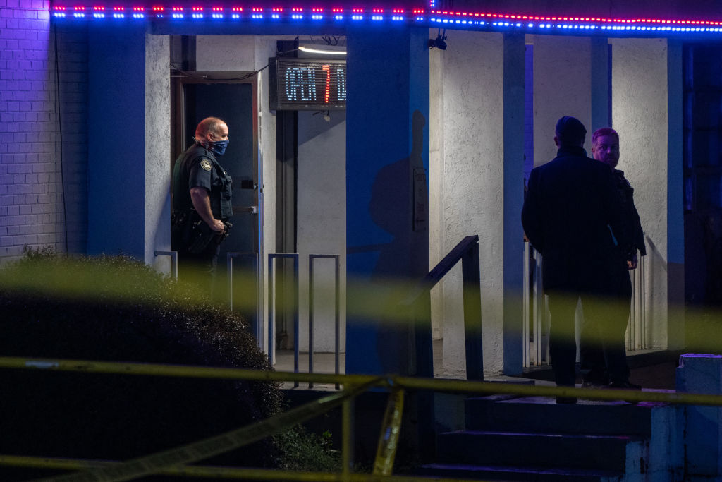 Police officers are seen outside a massage parlor where three people were shot and killed in Atlanta, Georgia, on March 16, 2021.