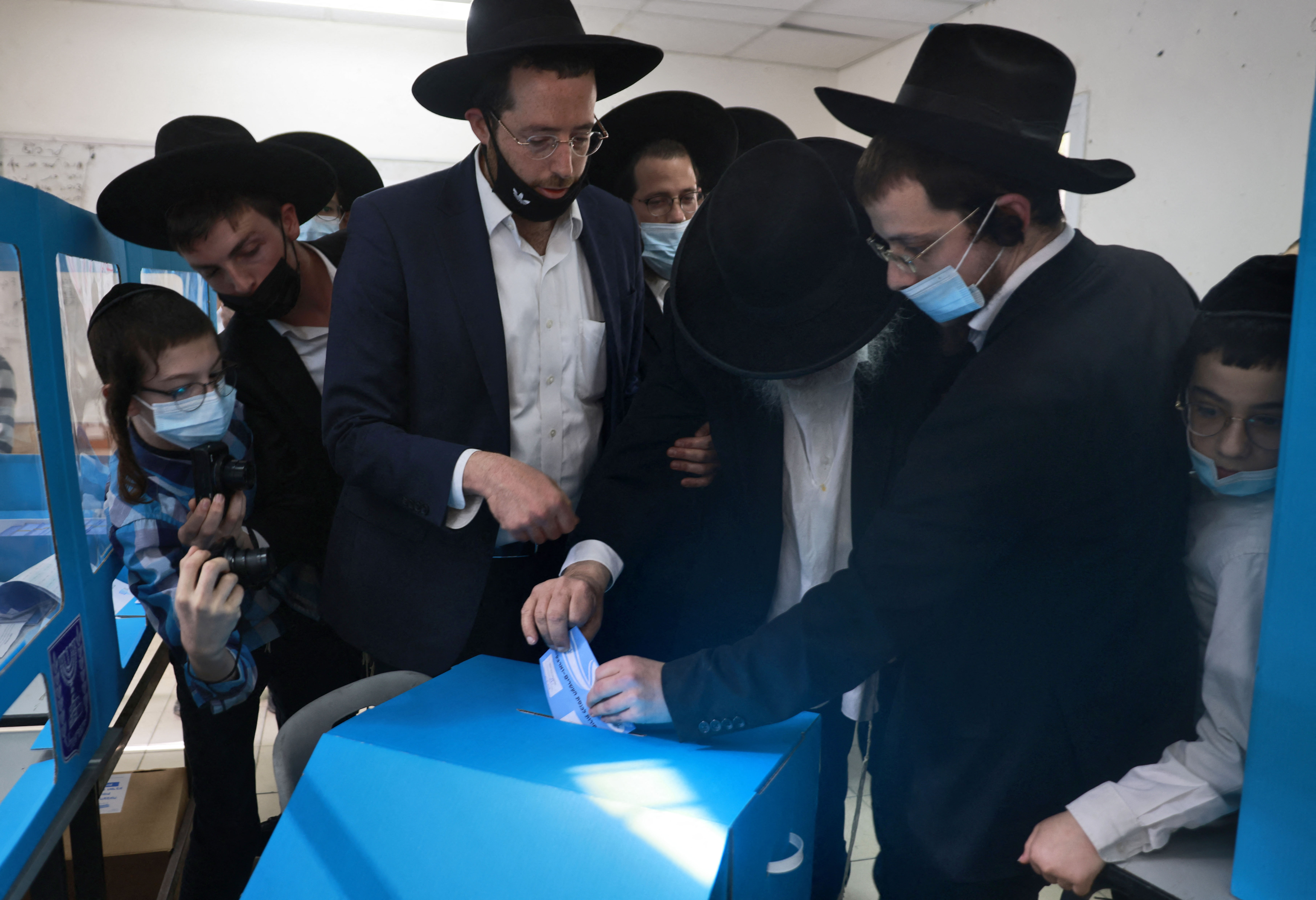 Religious Israelis cast their ballots on March 23, 2021 in the mostly Jewish ultra-Orthodox city of Bnei Brak on the fourth national election in two years.