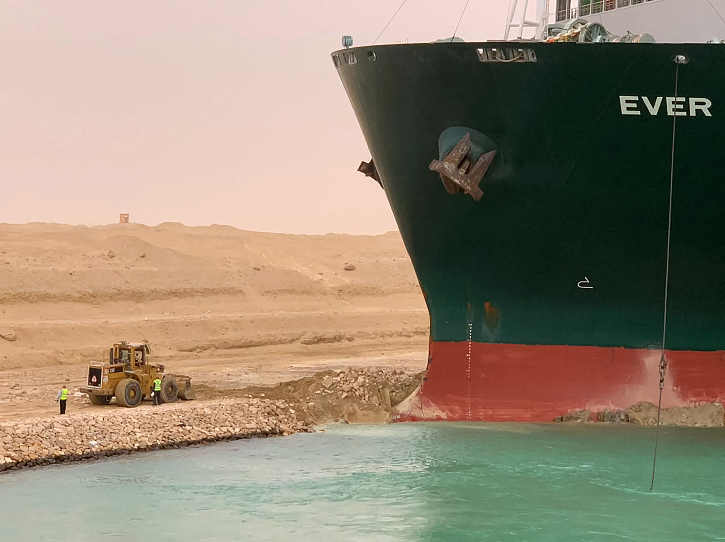 A handout picture released by the Suez Canal Authority on March 24, 2021 shows a part of the Taiwan-owned MV Ever Given (Evergreen), a 400-metre- (1,300-foot-) long and 59-metre wide vessel, lodged sideways and impeding all traffic across the waterway of Egypt's Suez Canal.