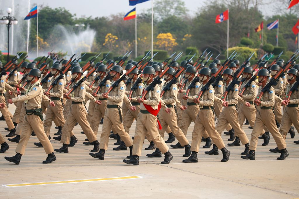 Soldiers march in formation during a parade to mark the 76th Armed Forces Day in Nay Pyi Taw, Myanmar, on March 27, 2021.
