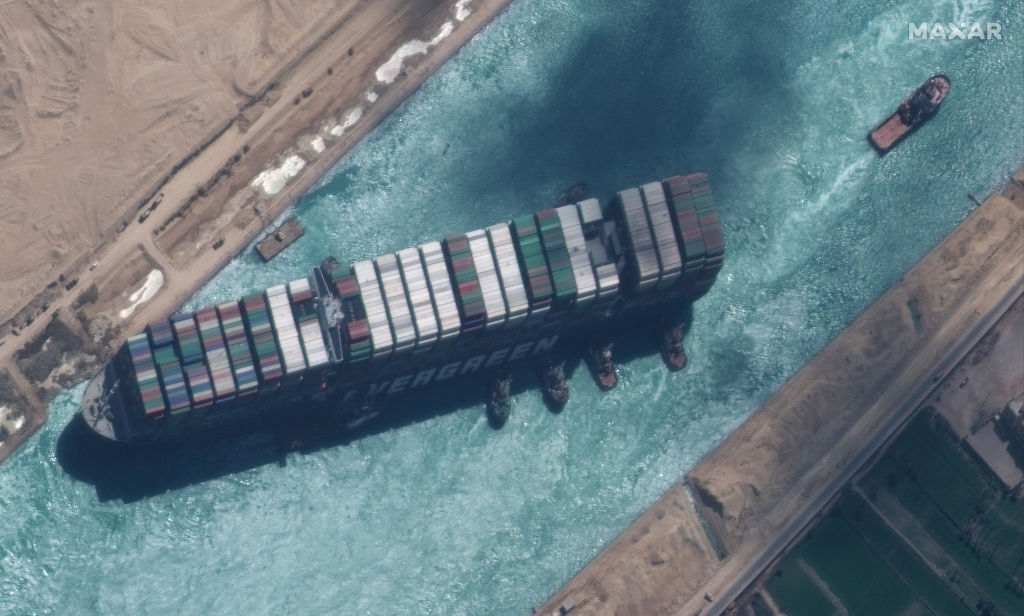 High-resolution satellite imagery of the Suez canal and the container ship (EVER GIVEN) and tugboats that have the ship nearly unstuck north of the city of Suez, Egypt on March 29