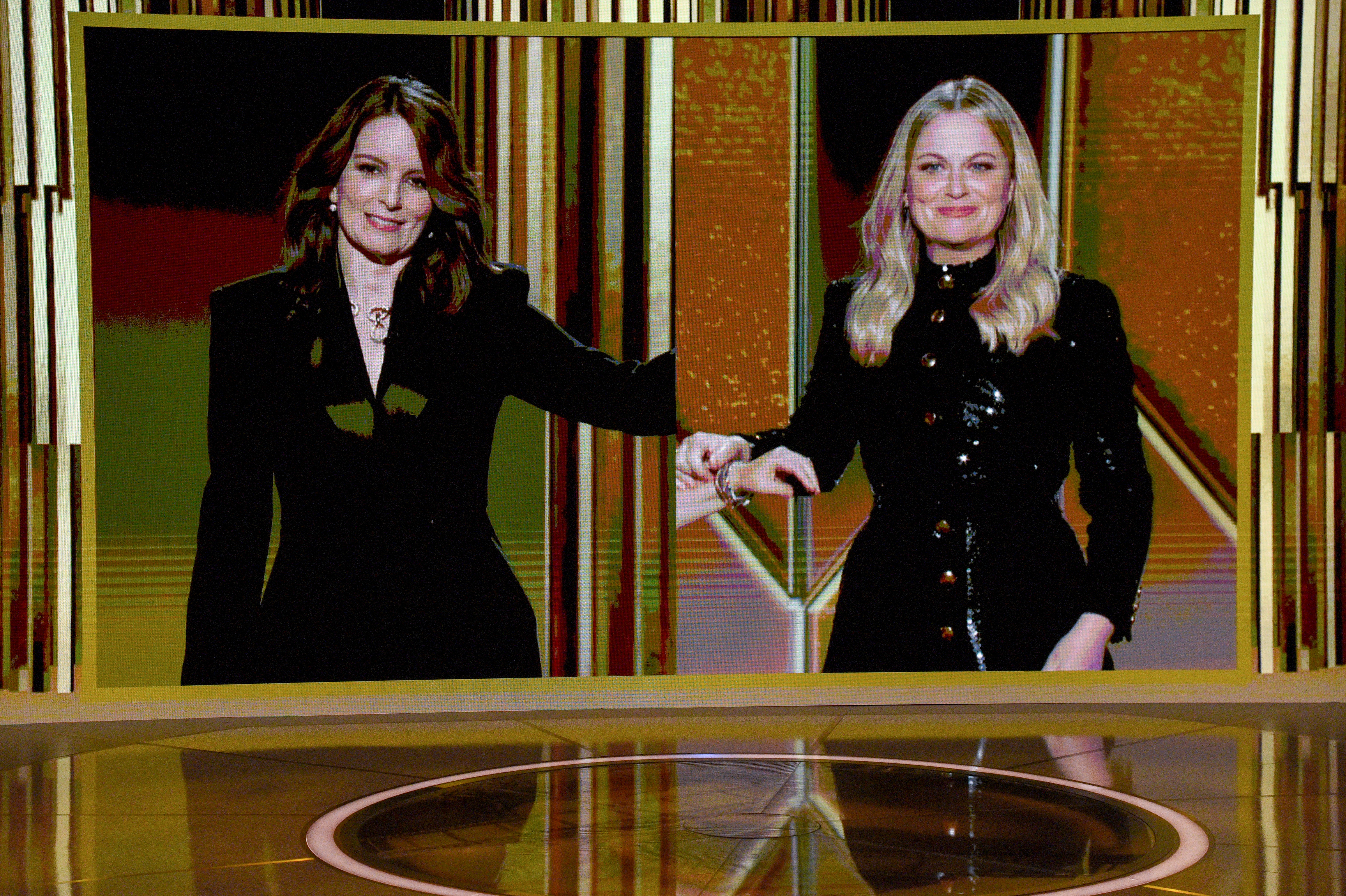 Tina Fey and Amy Poehler speak via livestream during the 78th Annual Golden Globe Awards on Feb. 28, 2021