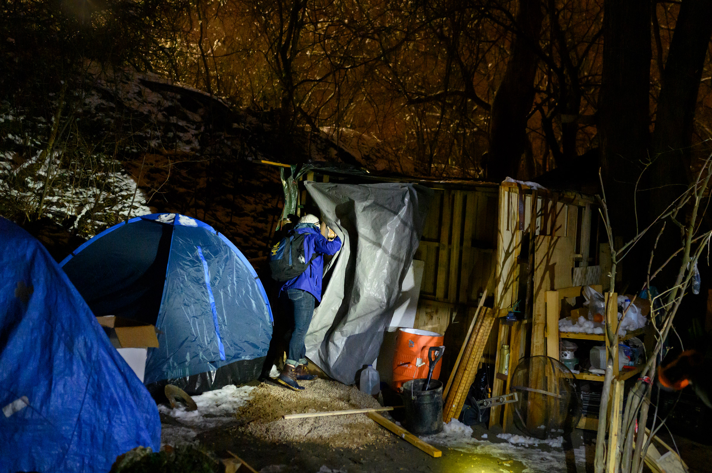 Nurse Crystal Bauer checks on a resident at a homeless encampment on Dec 18. Bauer helped start Project Hope, a street-medicine program supported through community donations.