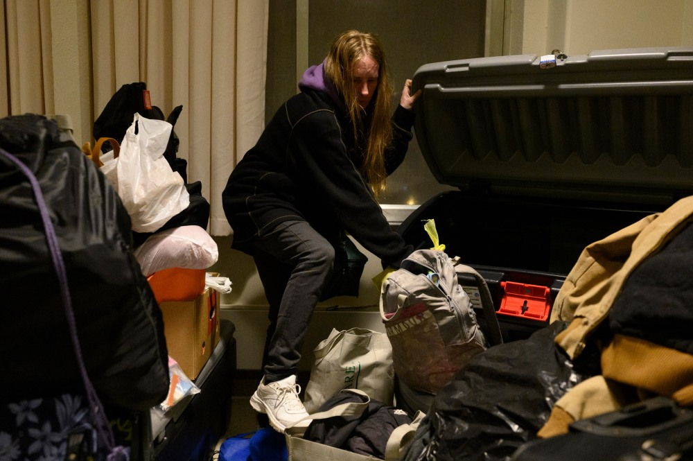 Dylon collects belongings that she has stored at the Winter Freeze shelter on its final night of operation for the year in Wheeling, WV on December 15, 2021.