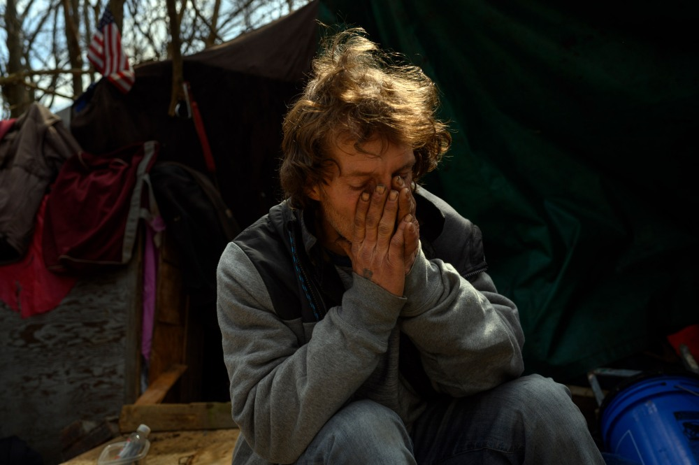 Ron returns to his tent encampment in Wheeling, WV on March 16, 2021 after the closing of the Winter Freeze shelter for the year. The shelter provides beds at night for the unhoused between mid-December to mid-March.