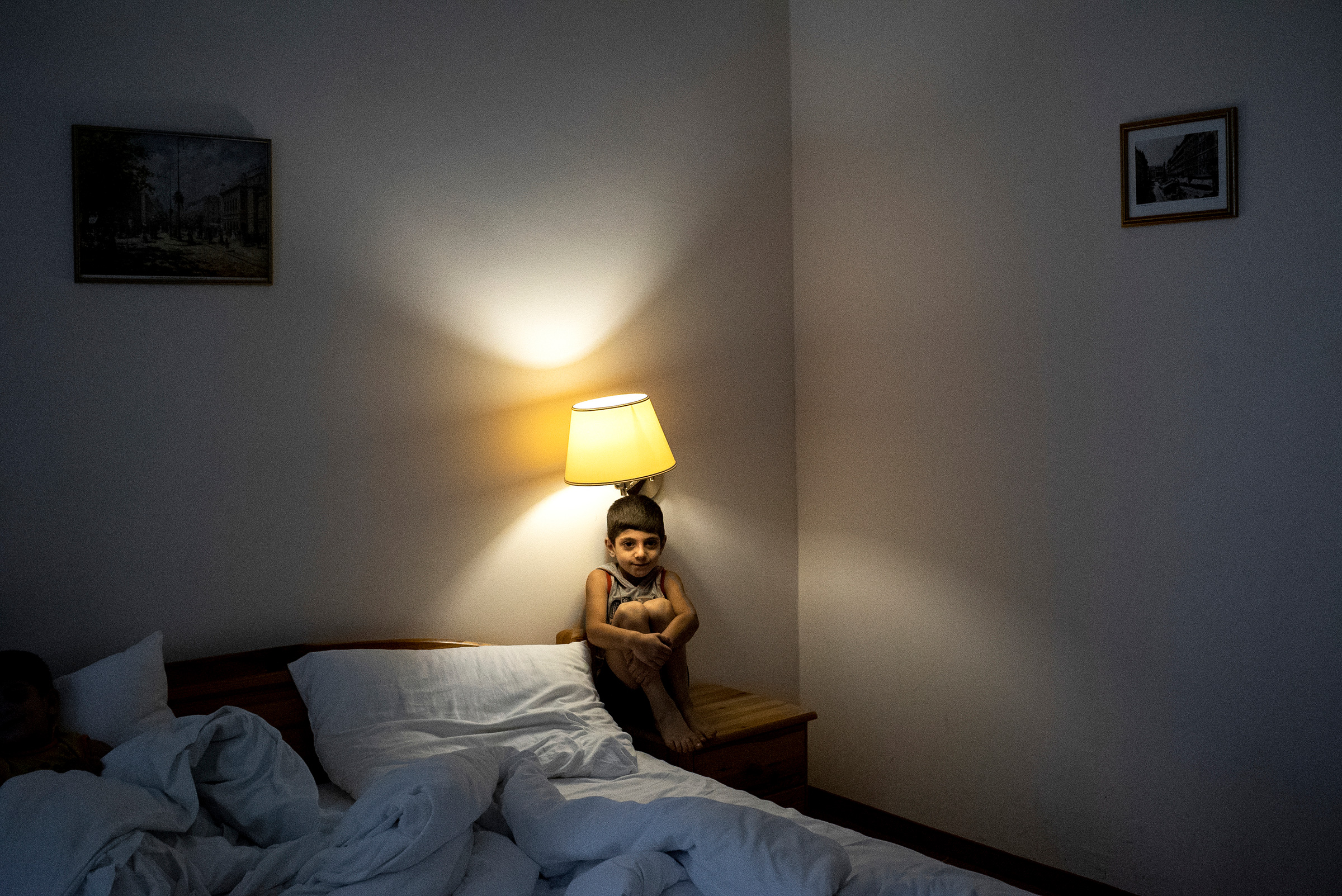 Ali, a Syrian refugee who arrived that evening in Vienna with his family after weeks on the refugee trail. The next day they continued their journey to a new life in Sweden. Vienna, 2015.