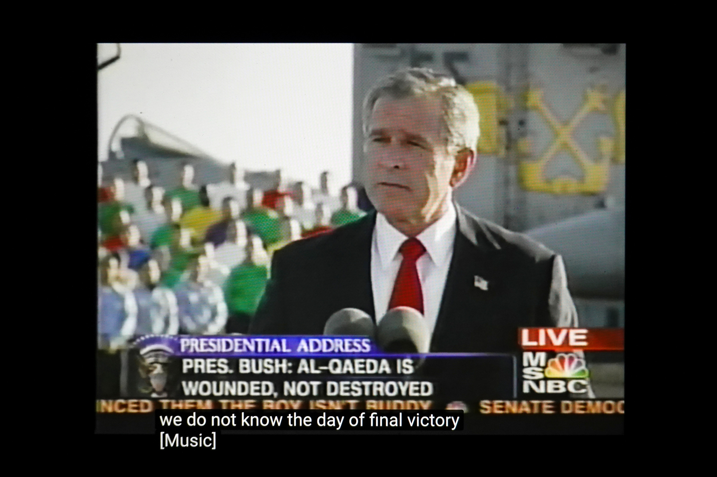 """President George W. Bush announces """"Mission Accomplished"""" regarding the war in Iraq on the aircraft carrier U.S.S. Abraham Lincoln on May 1, 2003. The vast majority of casualties and violence occurred after the speech."""