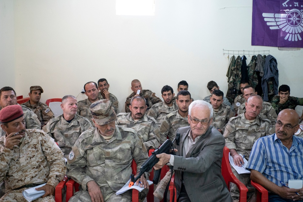 """A former Iraqi general volunteers to help a group of Assyrian Christian militia members being trained by the Sons of Liberty International, an organization dedicated to """"rais- ing a Christian army to fight†ISIS. As ISIS rampaged through northern Iraq, Iraqi Christians were particu- larly at risk, and many fled and were killed as ISIS desecrated their an- cient towns.Duhok. Iraq. 2015."""