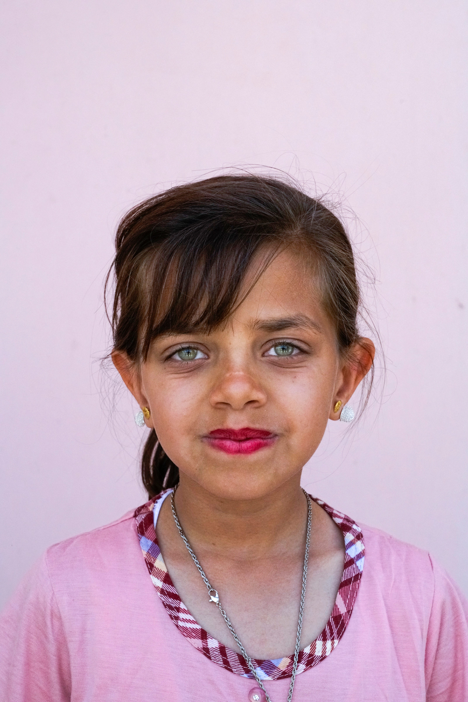 A portrait of a young Yazidi girl in a town recently liberated from ISIS. Bashiqa, Iraq, 2017.