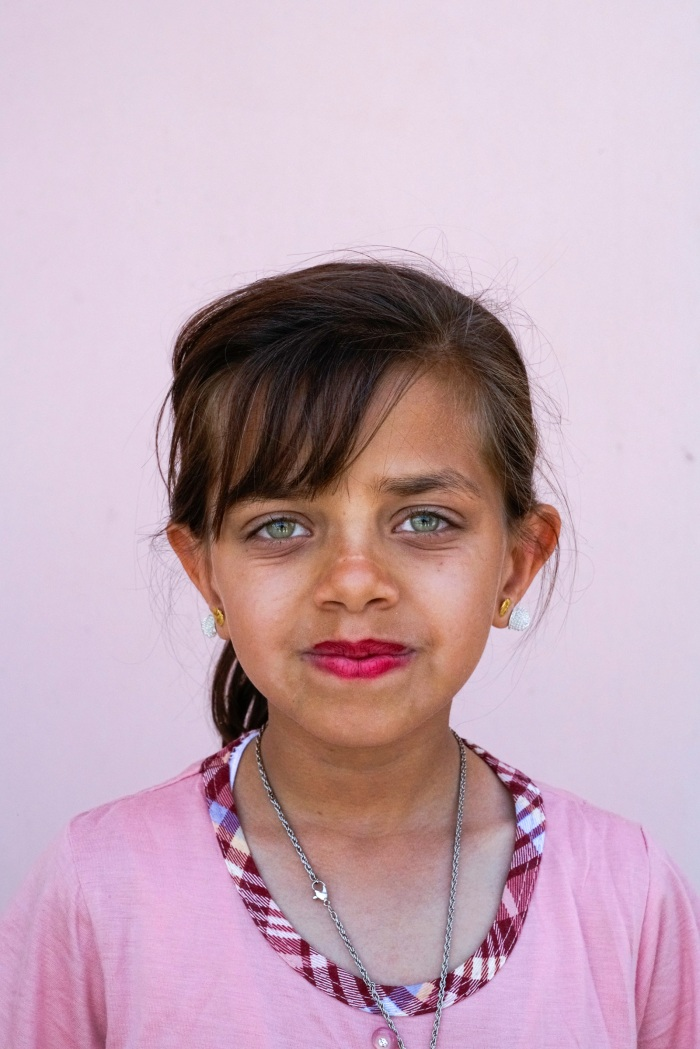 A portrait of a young Yazidi girl in a town recently liberated from ISIS. Bashiqa. Iraq. 2017.
