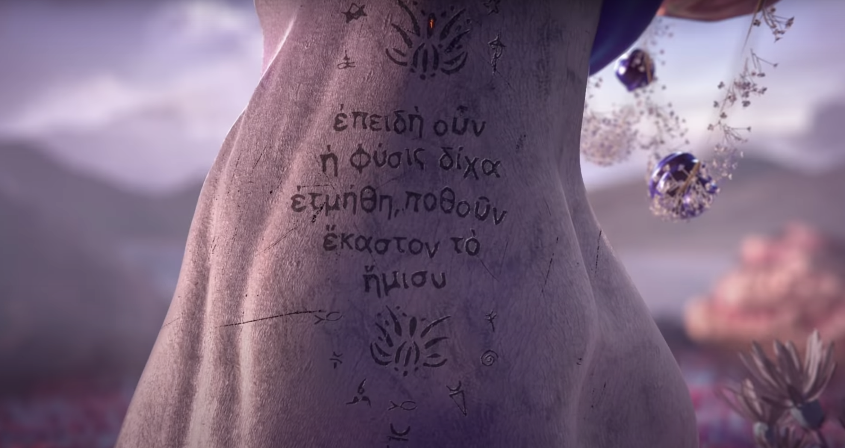 The tree of life, inscribed with a passage from Plato's  Symposium,  in Lil Nas X's  Montero.