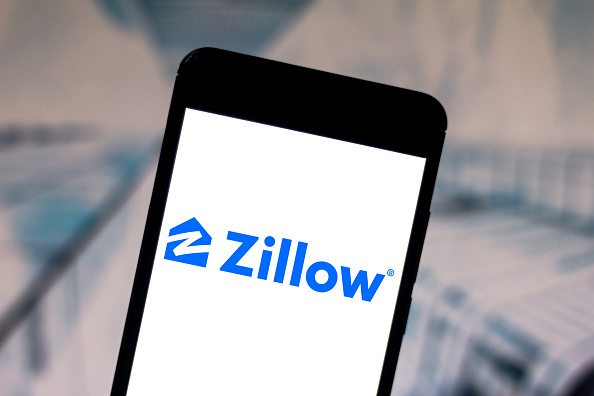 In this photo illustration, the Zillow Group logo is seen displayed on a smartphone.