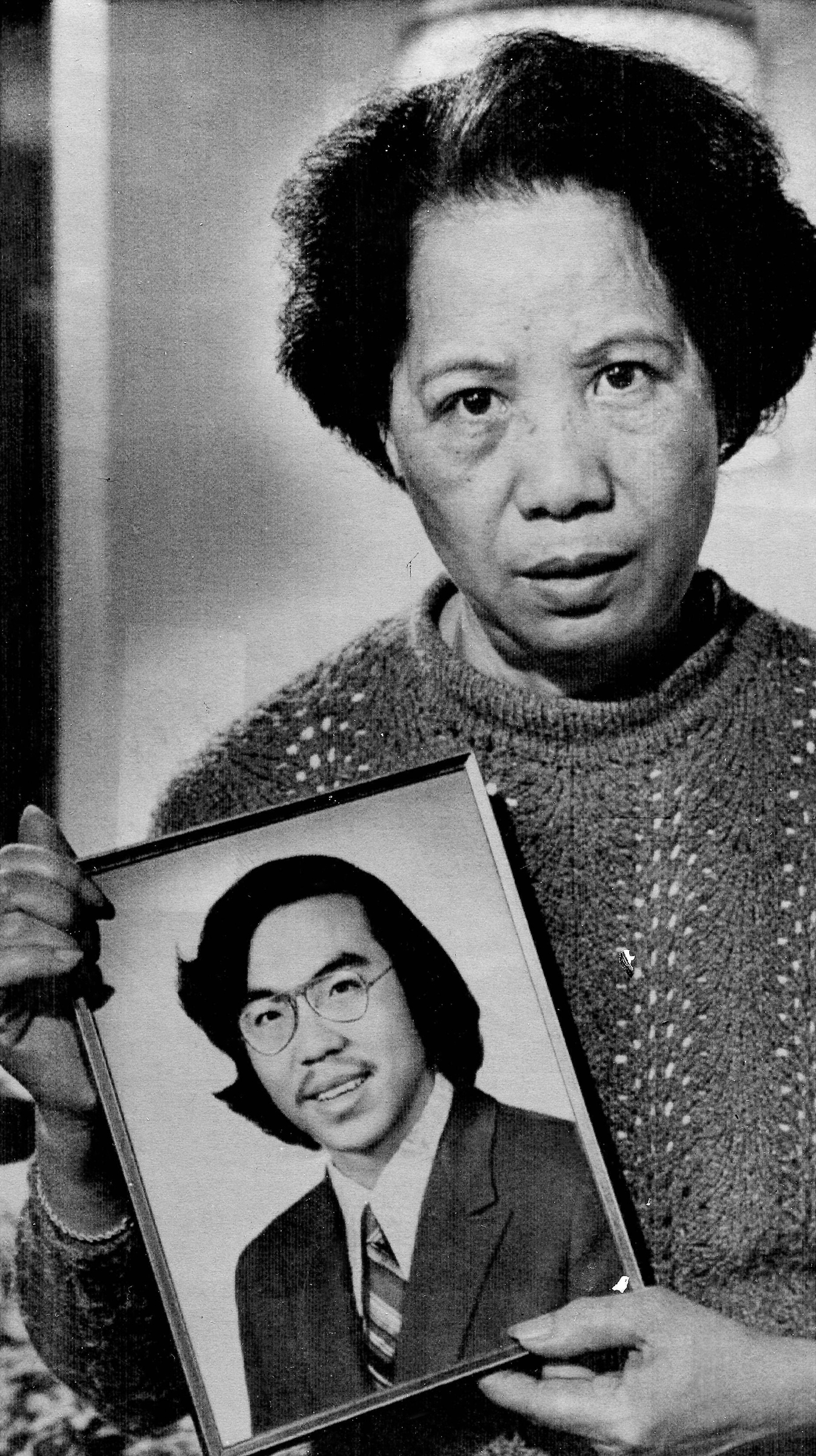 In this Nov. 2, 1983, photo, Lily Chin holds a photograph of her Chinese-American son Vincent, who died on June 23, 1982, at the age of 27, four days after being brutally beaten in Detroit by two white men who thought he was Japanese and blamed him for the loss of American auto industry jobs.
