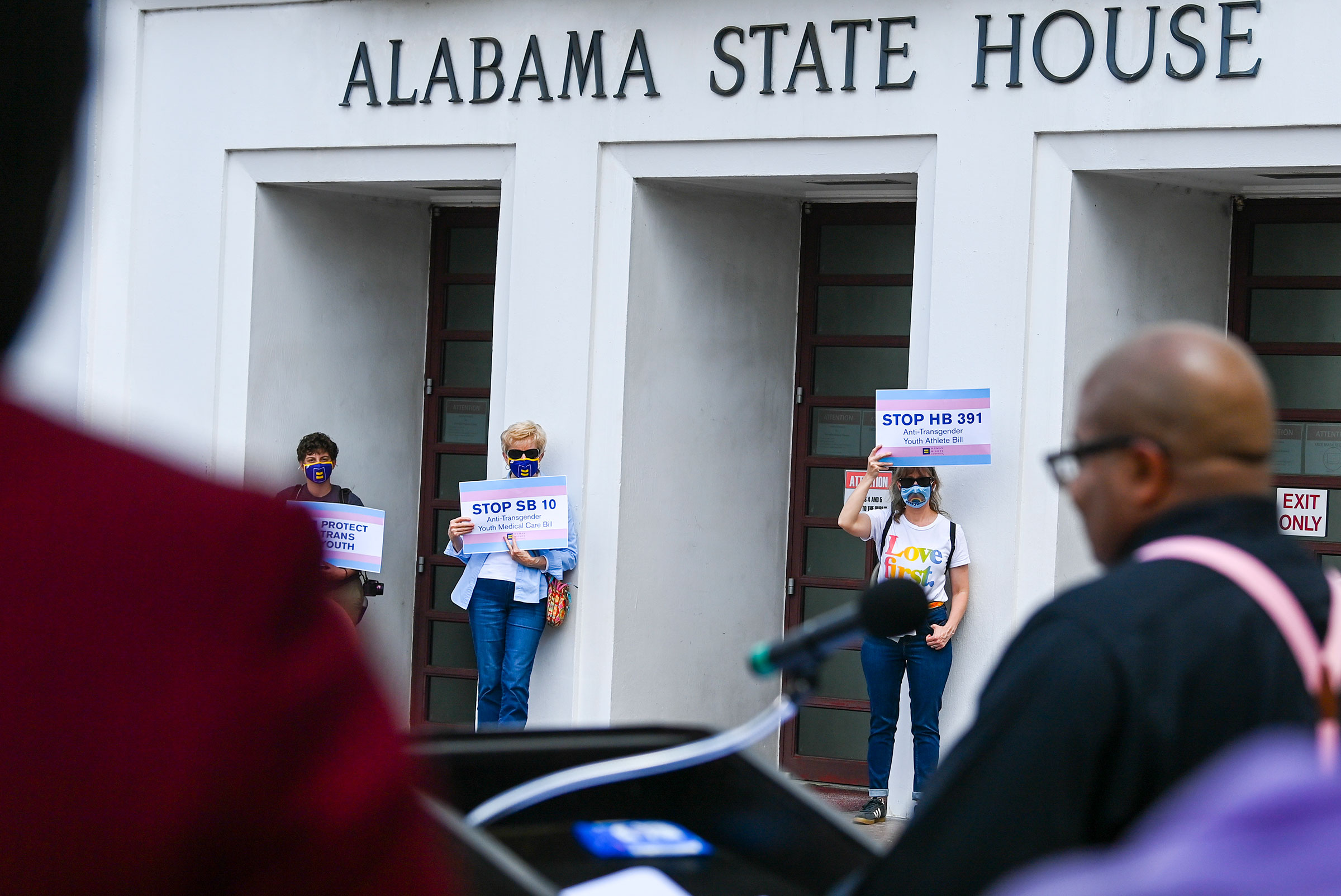 Opponents of several bills targeting transgender youth attend a rally at the Alabama State House to draw attention to anti-transgender legislation introduced in Alabama on March 30, 2021.