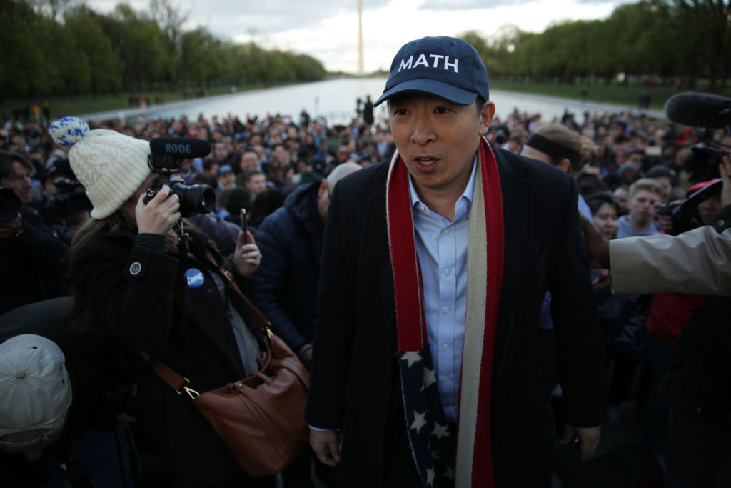 Democratic U.S. presidential hopeful Andrew Yang hosts a campaign rally at the Lincoln Memorial April 15, 2019 in Washington, DC. One of Yang's major campaign promises is a universal basic income proposal to give every American 18 years and older $1,000 every month.