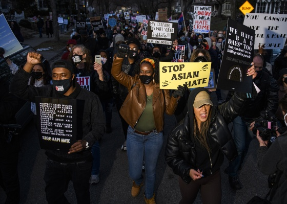 People march through a neighborhood to protest against anti-Asian violence on March 18 in Minneapolis