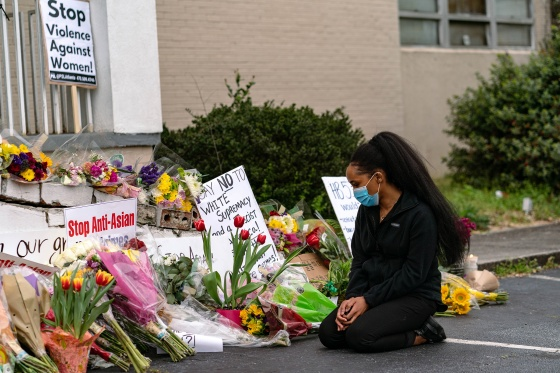 A mourner at a makeshift memorial for the victims of a shooting at Gold Spa in Acworth, Ga., March 19