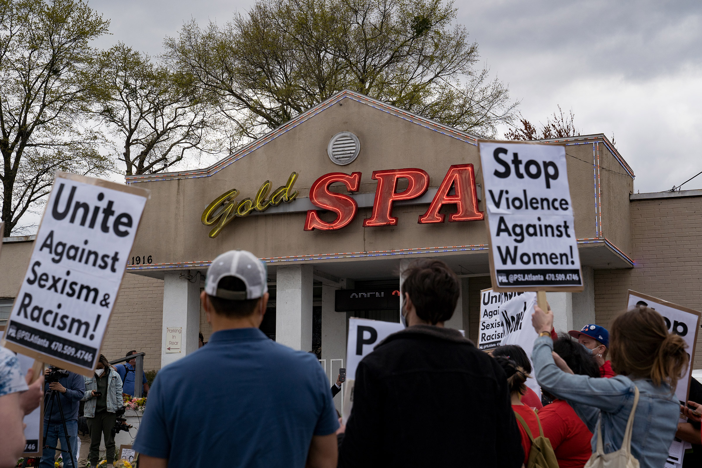 Activists demonstrate outside Gold Spa following Tuesday night's shooting, in Atlanta, Ga., on March 18, 2021.