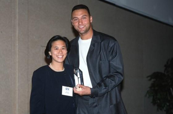 Ng receiving an award from Derek Jeter in 2000