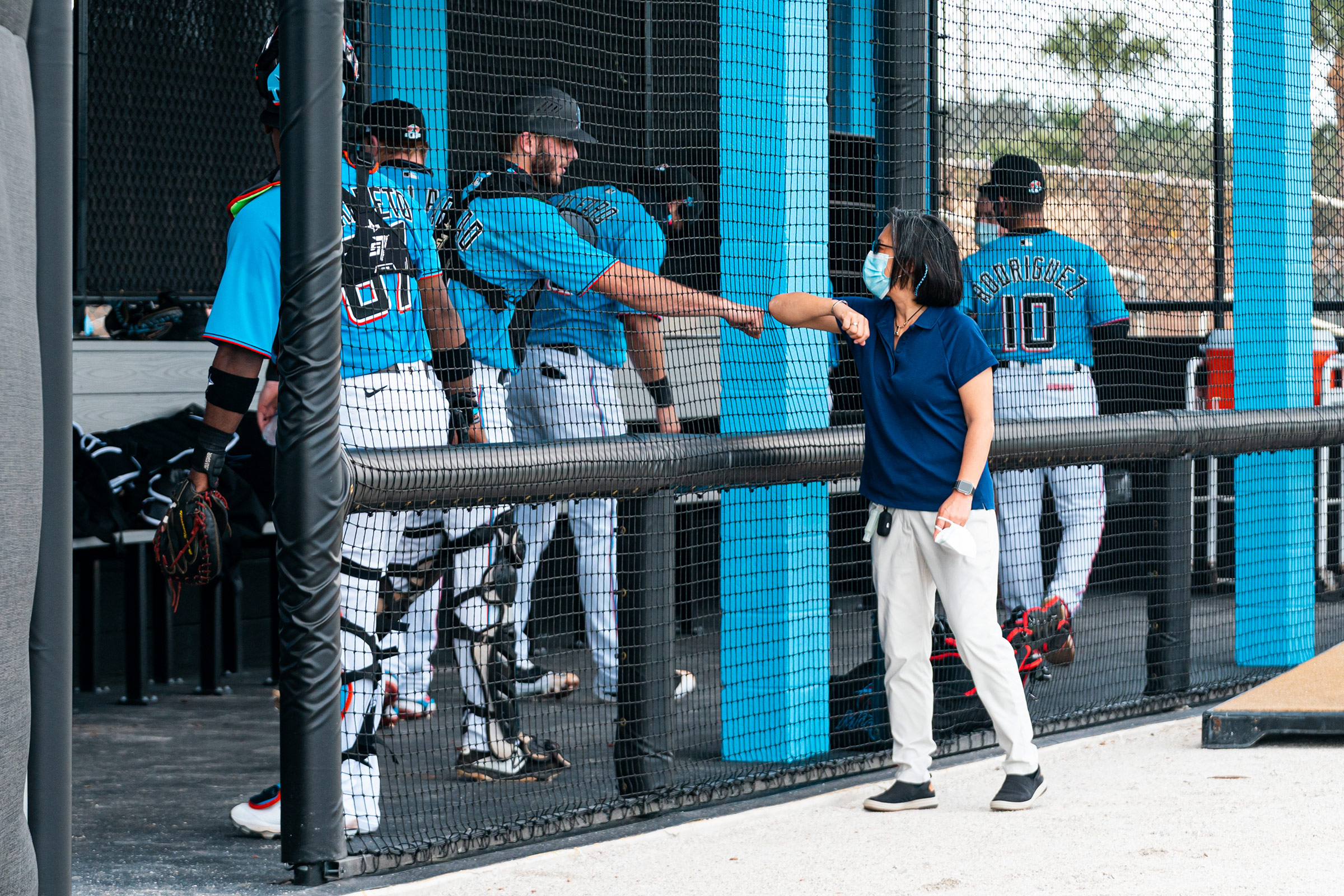 Ng greets Miami Marlins prospect Cameron Barstad on Feb.18, the opening day of spring training, in Jupiter, Fla.