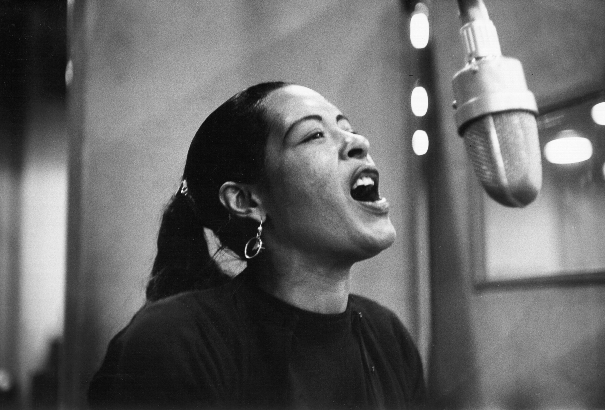 Singer Billie Holiday records her penultimate album at the Columbia Records studio in New York in Dec. 1957.