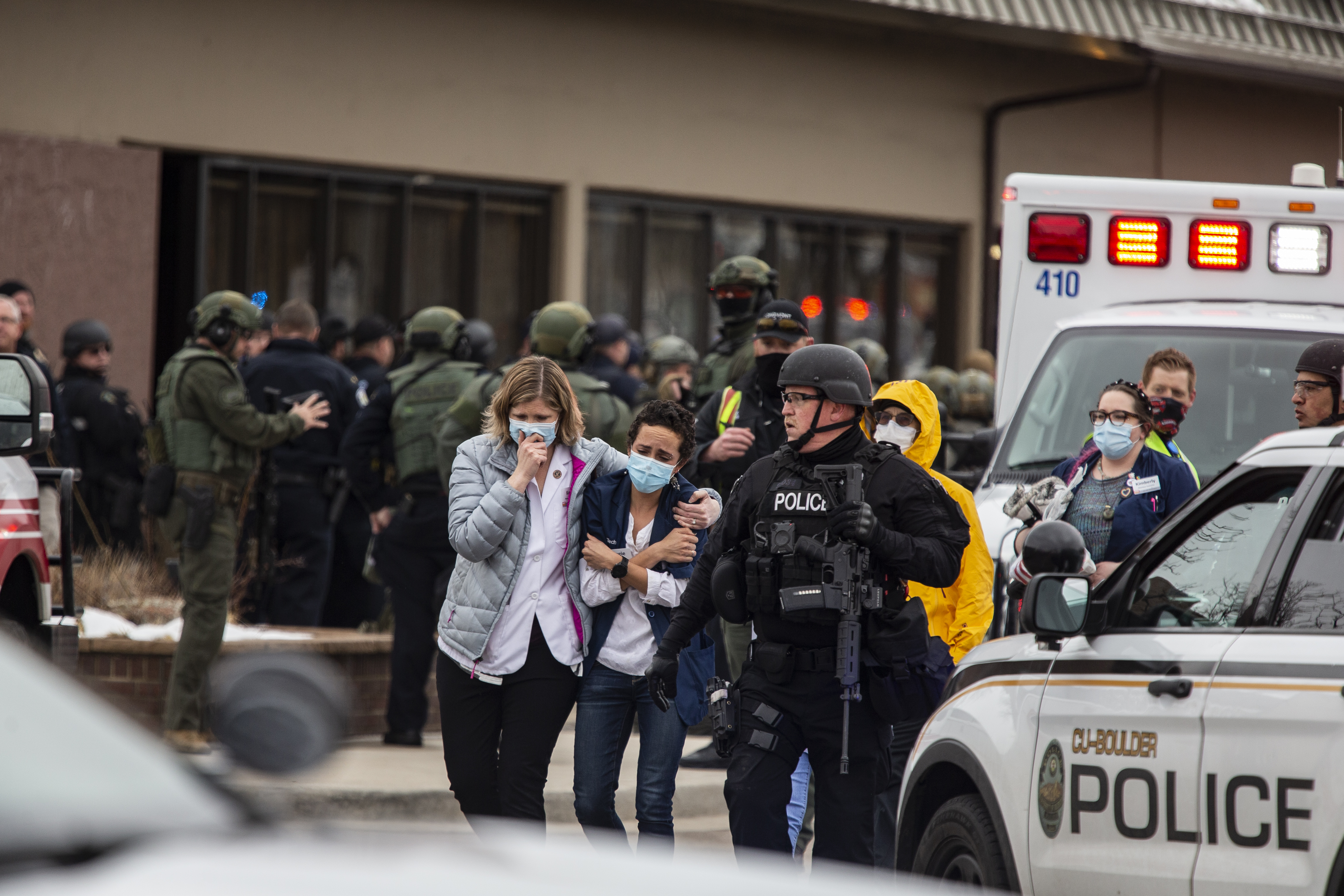 People exit a grocery store after a gunman opened fire on March 22, 2021 in Boulder, Colorado.