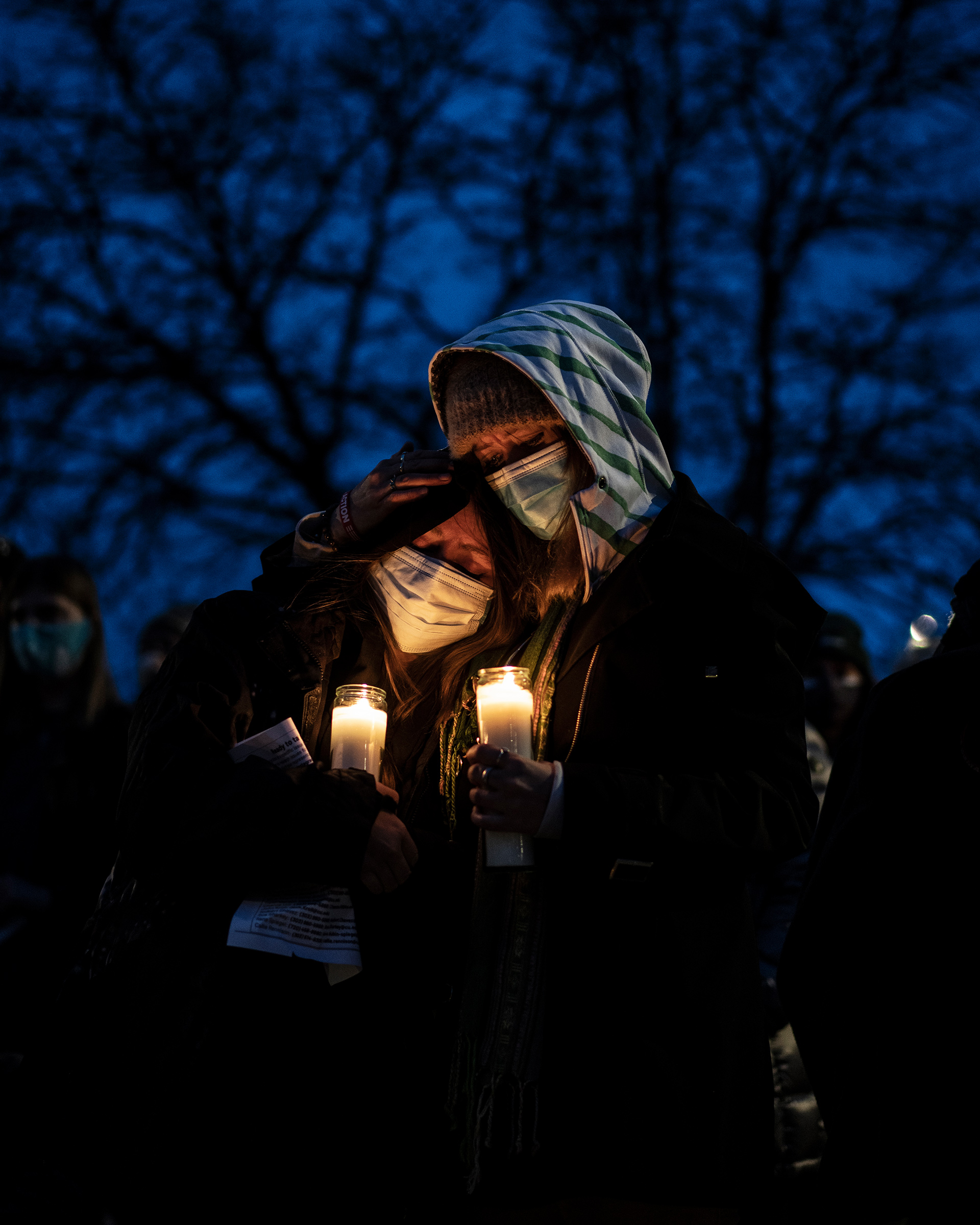 Mourners attend a vigil to commemorate the victims of a mass shooting at a King Soopers grocery store in Boulder, C., on March 25, 2021.