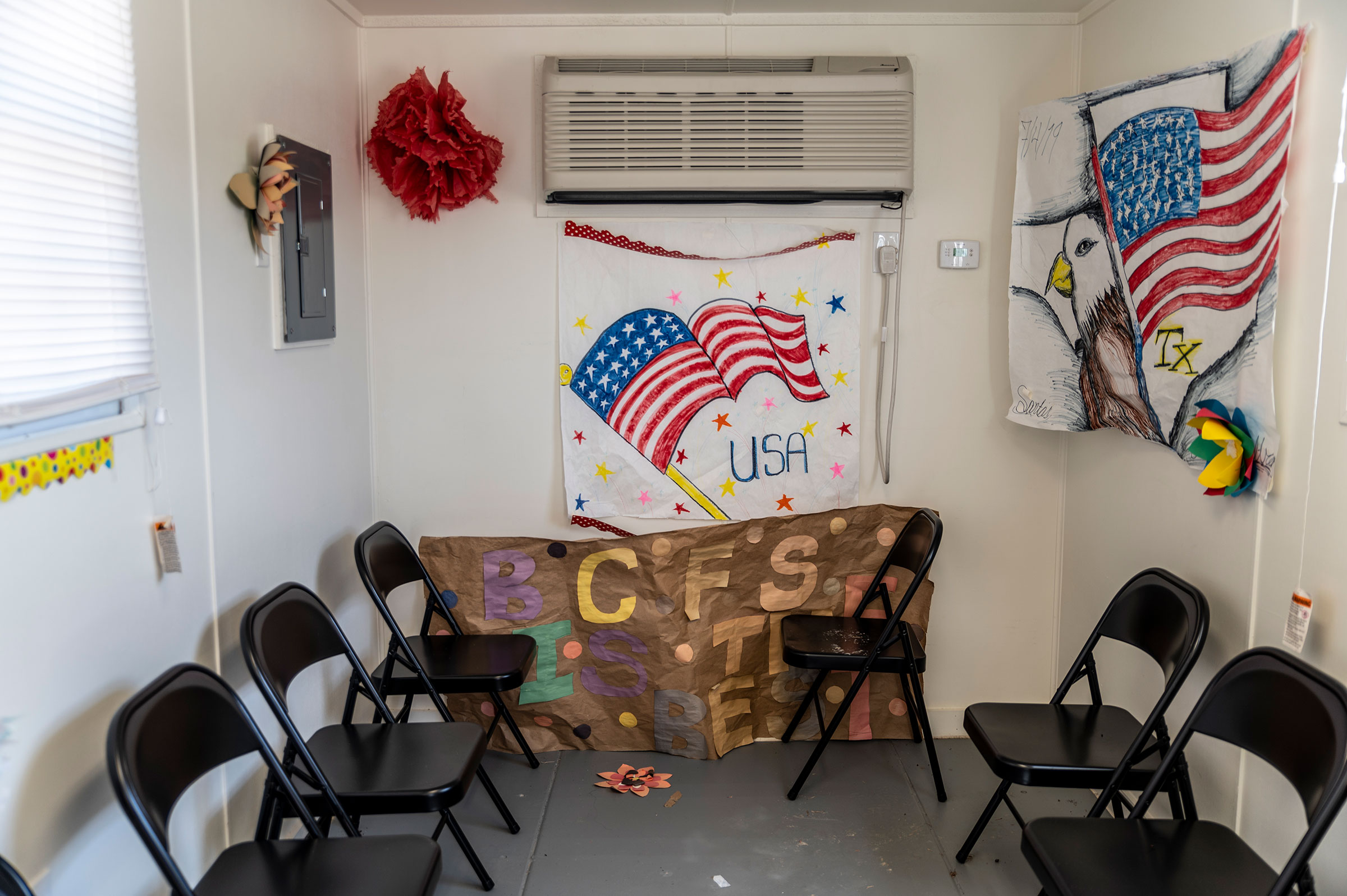 Artwork made by previous residents hangs inside a welcome center at a Influx Care Facility for unaccompanied children in Carrizo Springs, TX  on Feb. 21, 2021.
