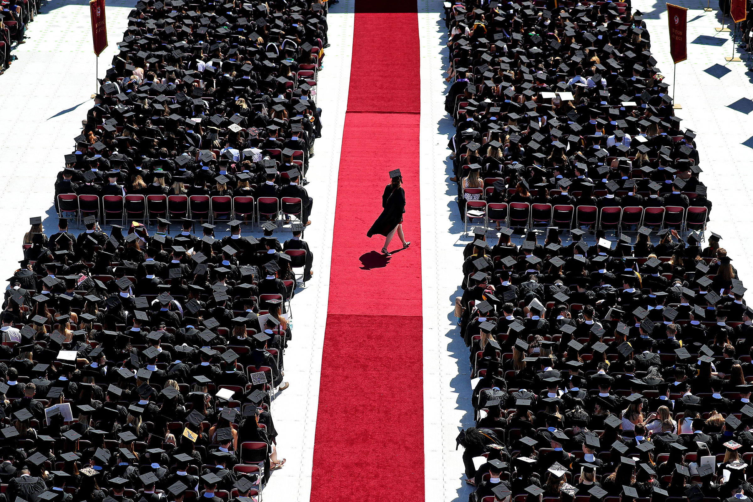A graduate crosses the red carpet at Boston College's commencement on May 21, 2018