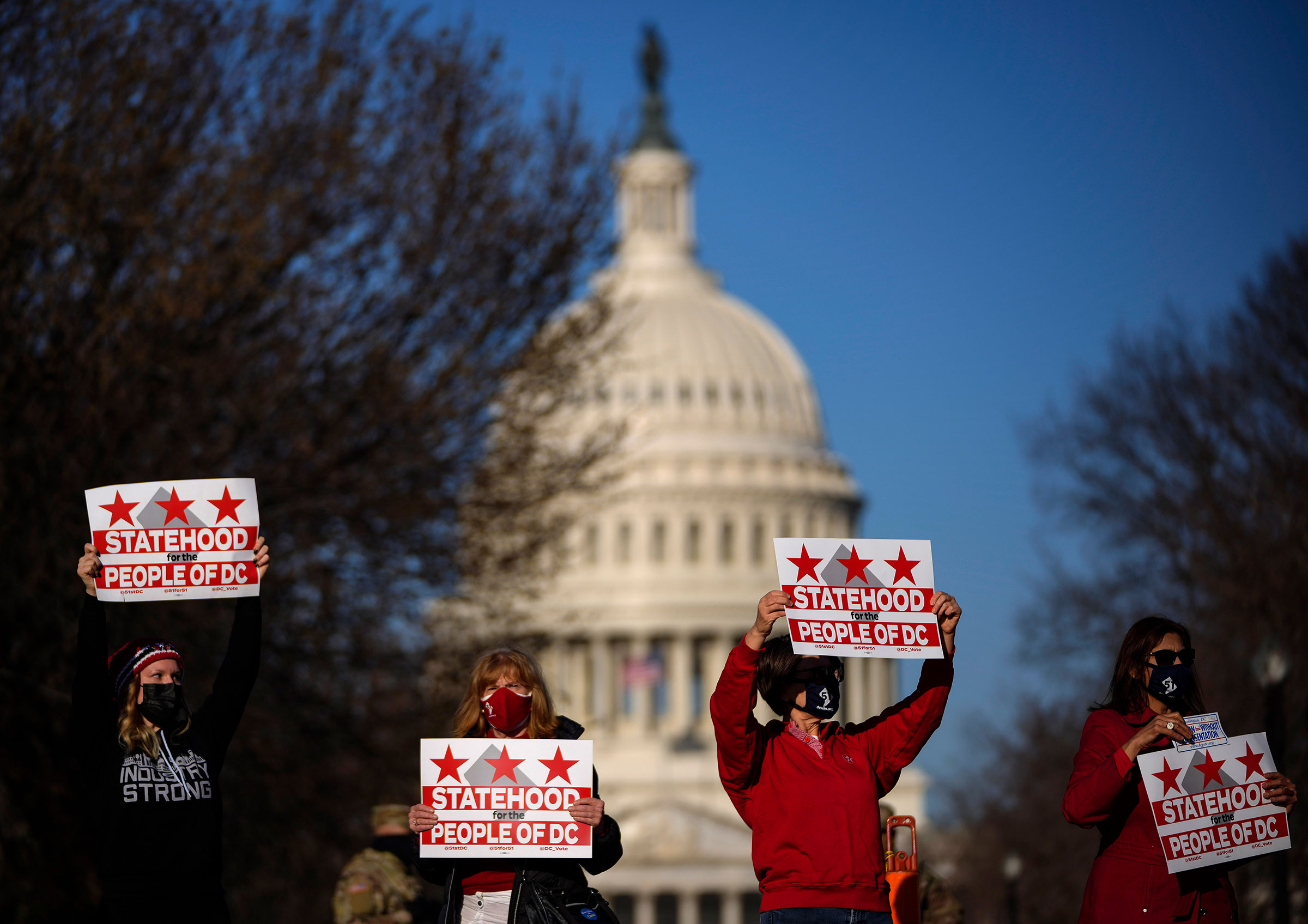 Residents of D.C. rally for statehood near the Capitol in Washington on March 22, 2021.