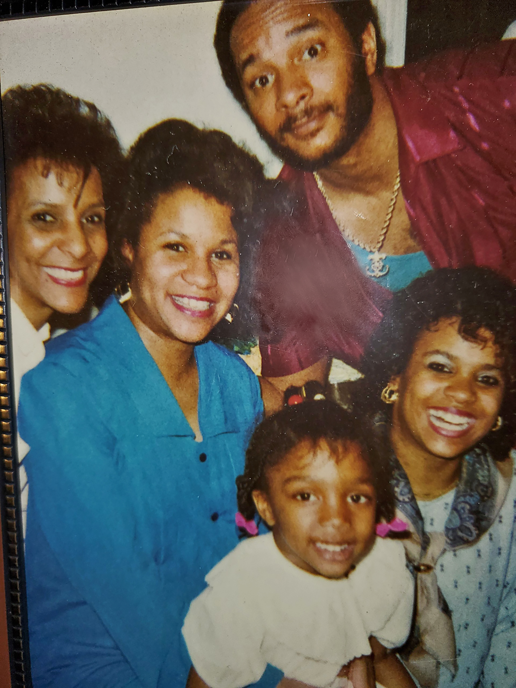 Christopher Burns in a 1990s family photo with his mother, two sisters and daughter Keli, front