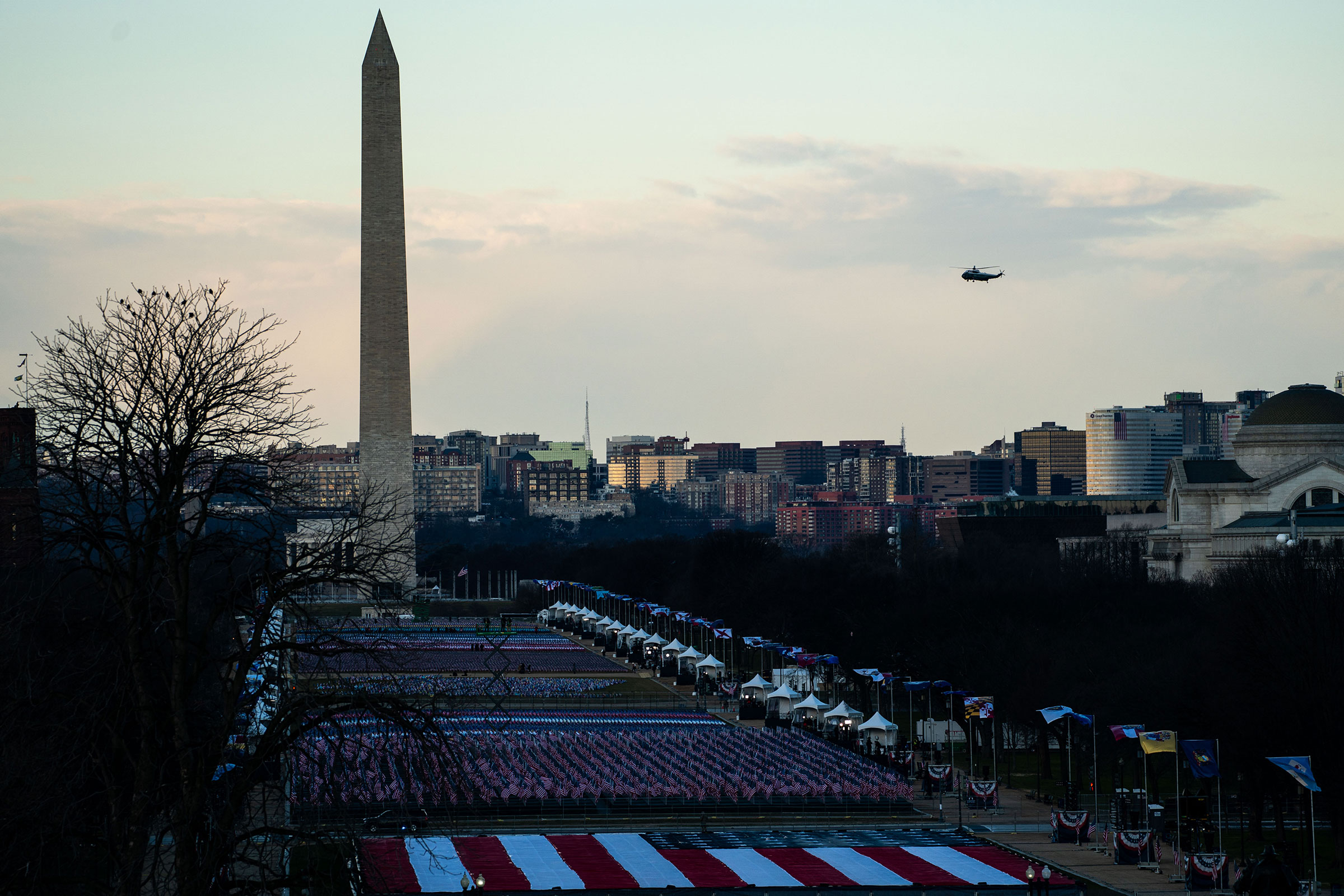 Marine One flies by the Washington Monument as President Donald Trump departs Washington on the morning of the 59th Presidential Inauguration ceremonies on Jan. 20, 2021.