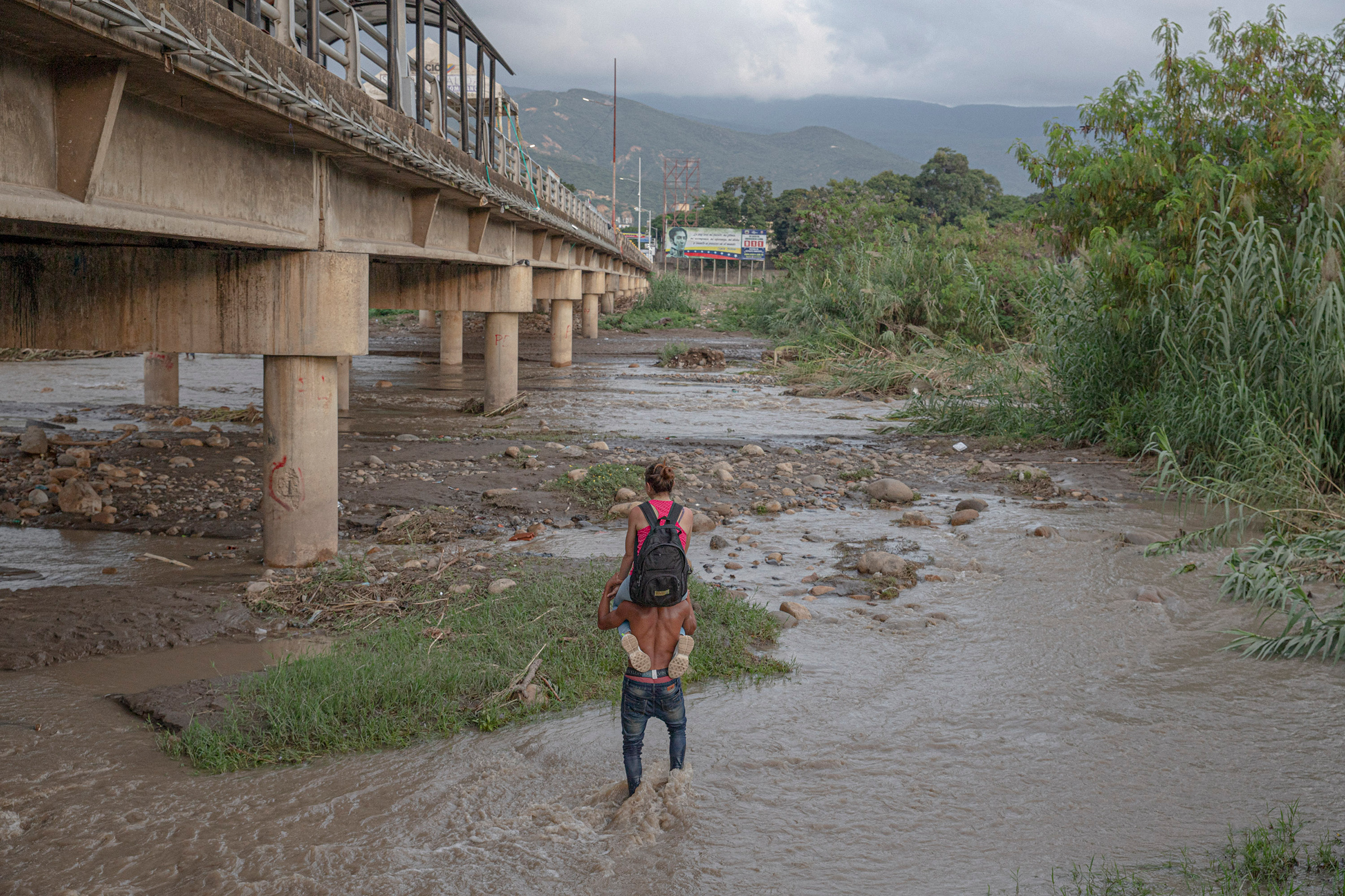 A man carries a woman across the Táchira River, which marks the border between Venezuela and Colombia, in November.