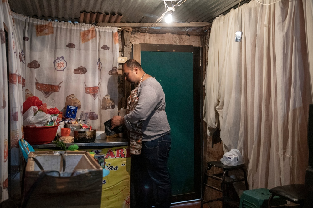 Nixon Valera, who arrived in 2018, wakes at 5:30 a.m. every day to make empanadas to sell on the streets of Bogotá; in Venezuela, he worked in the plastics industry.