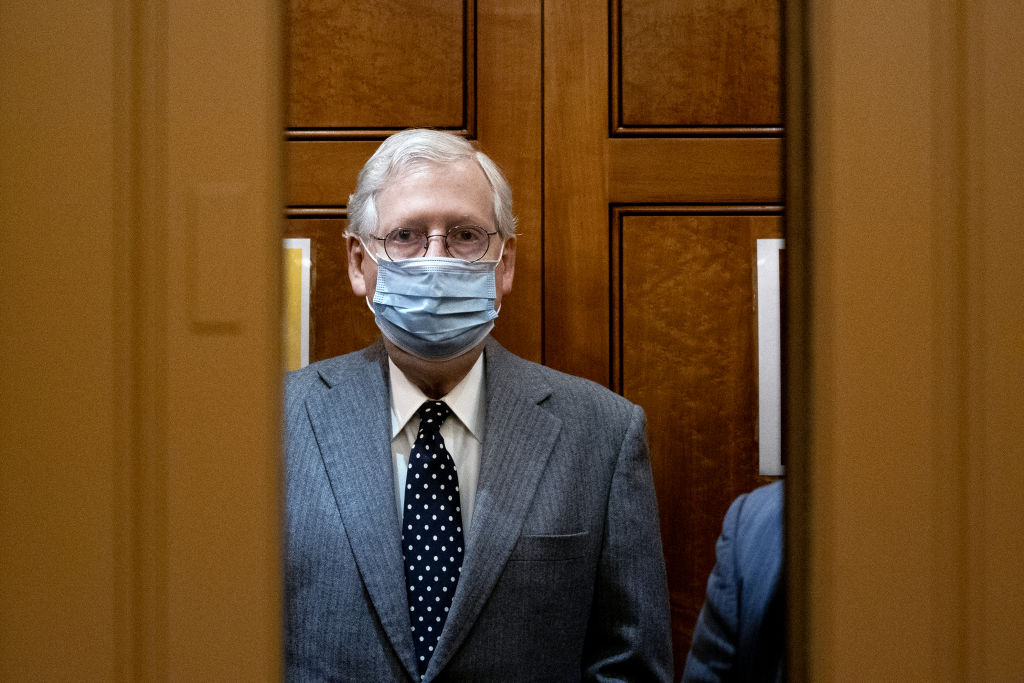Senate Minority Leader Mitch McConnell, a Republican from Kentucky, stands in an elevator at the U.S. Capitol following the Senate Republican luncheon in Washington, D.C., U.S., on Wednesday, March 3, 2021.