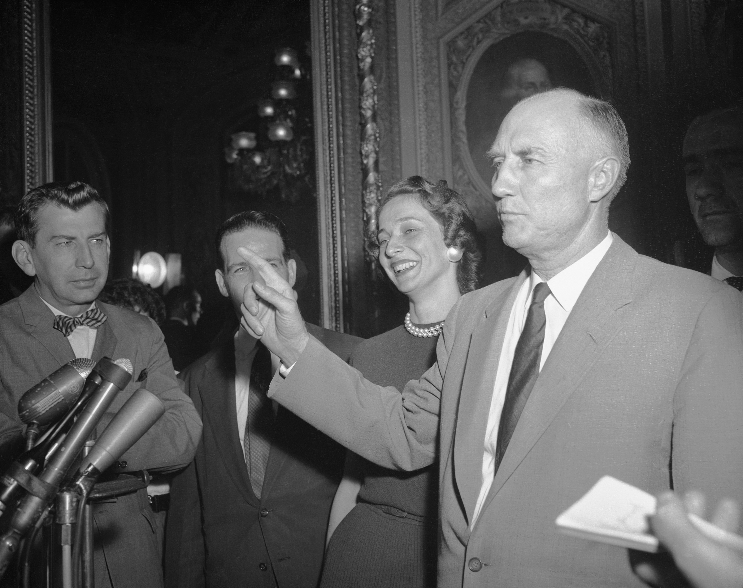 Sen. Strom Thurmond speaks with reporters after ending the longest filibuster on record — a 24-hour, 18-minute talkathon against the Civil Rights Act of 1957 in the Senate Chamber — Washington, D.C. on Aug. 29, 1957.