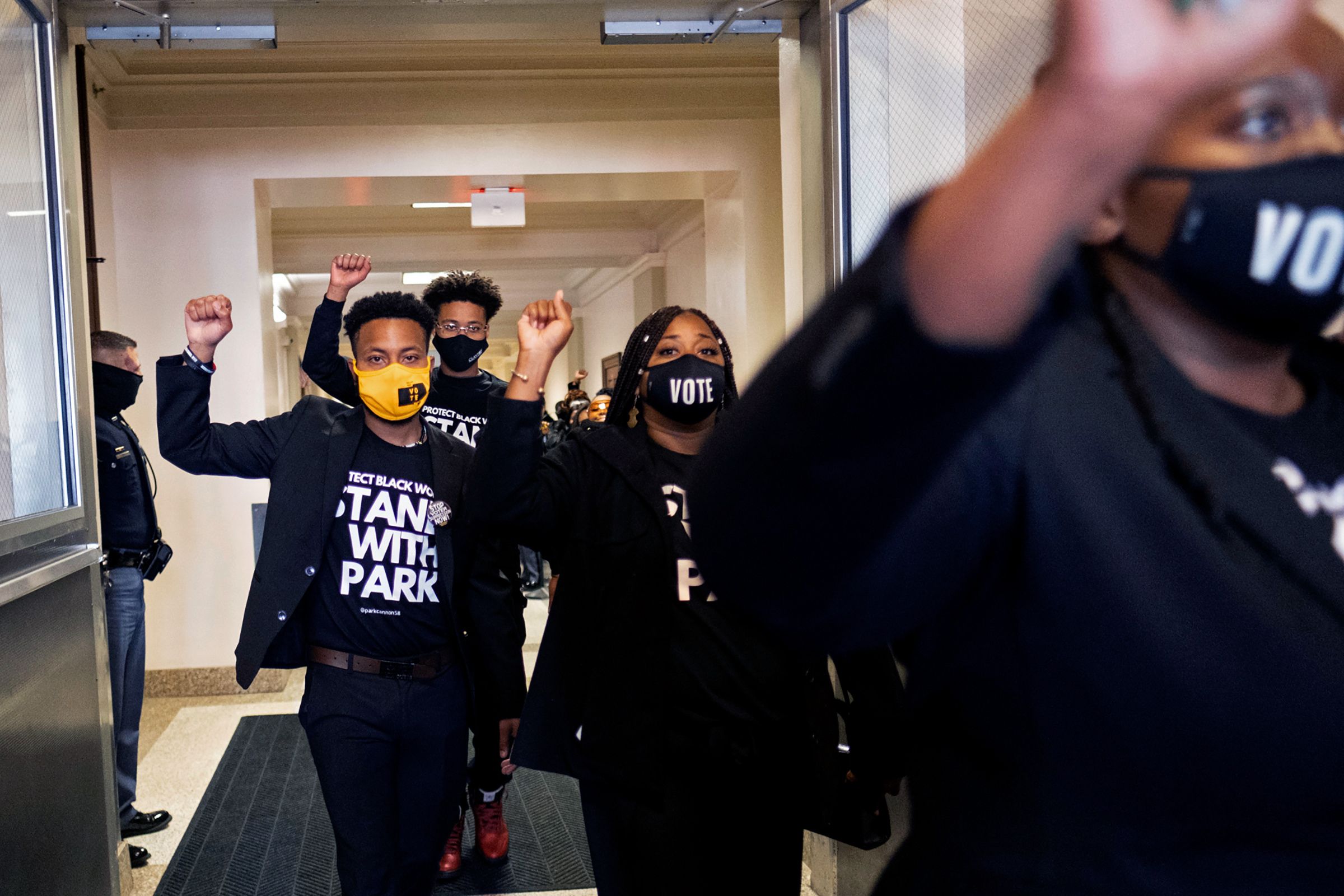 Supporters of Georgia State Rep. Park Cannon leave the State Capitol in Atlanta on Monday morning, March 29, 2021 after escorting her into the building.