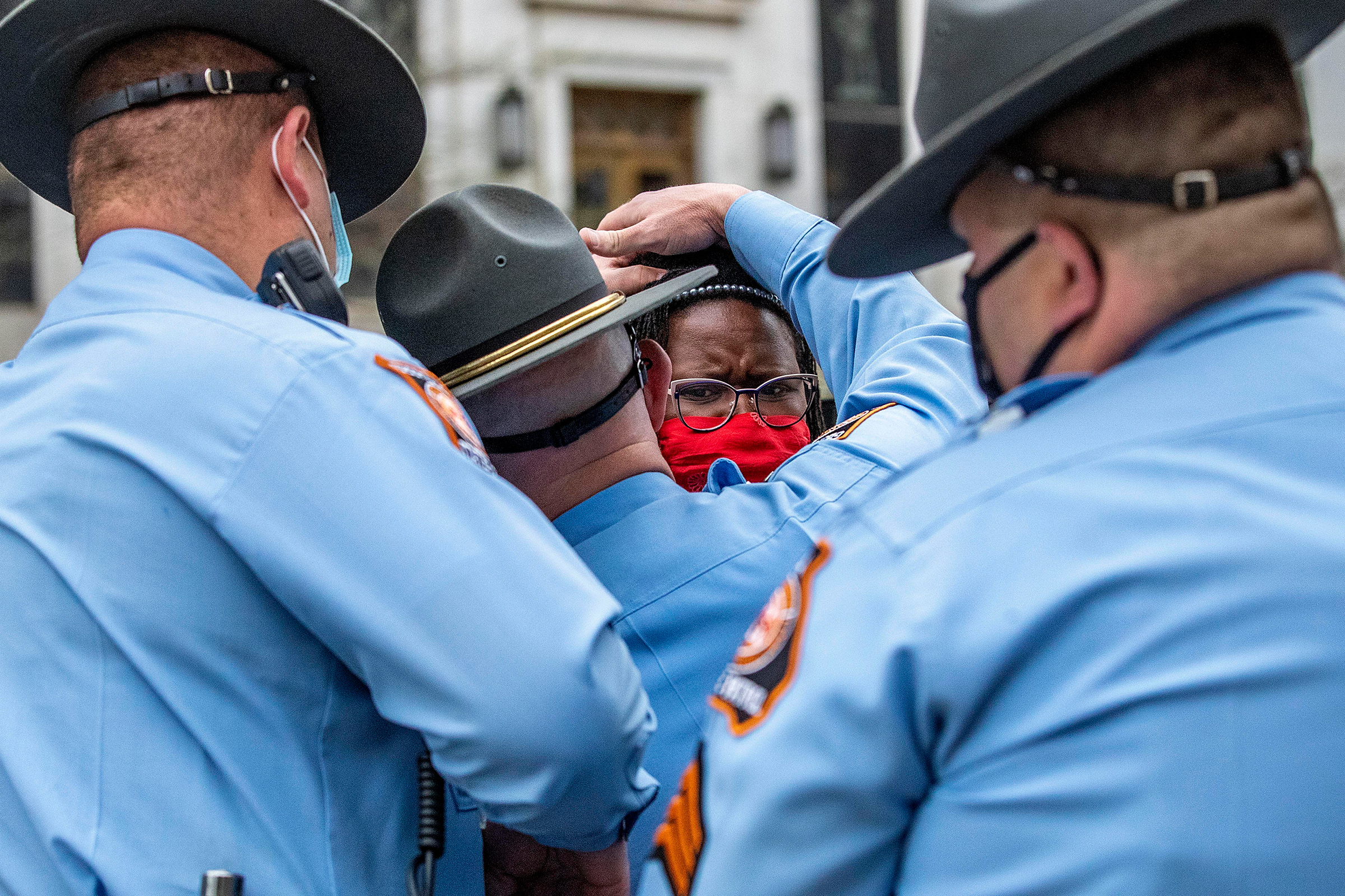State Rep. Park Cannon, D-Atlanta, is placed into the back of a Georgia State Capitol patrol car after being arrested by Georgia State Troopers at the Georgia State Capitol Building in Atlanta, Thursday, March 25, 2021. Cannon was arrested by Capitol police after she attempted to knock on the door of the Gov. Brian Kemp office during his remarks after he signed into law a sweeping Republican-sponsored overhaul of state elections that includes new restrictions on voting by mail and greater legislative control over how elections are run.