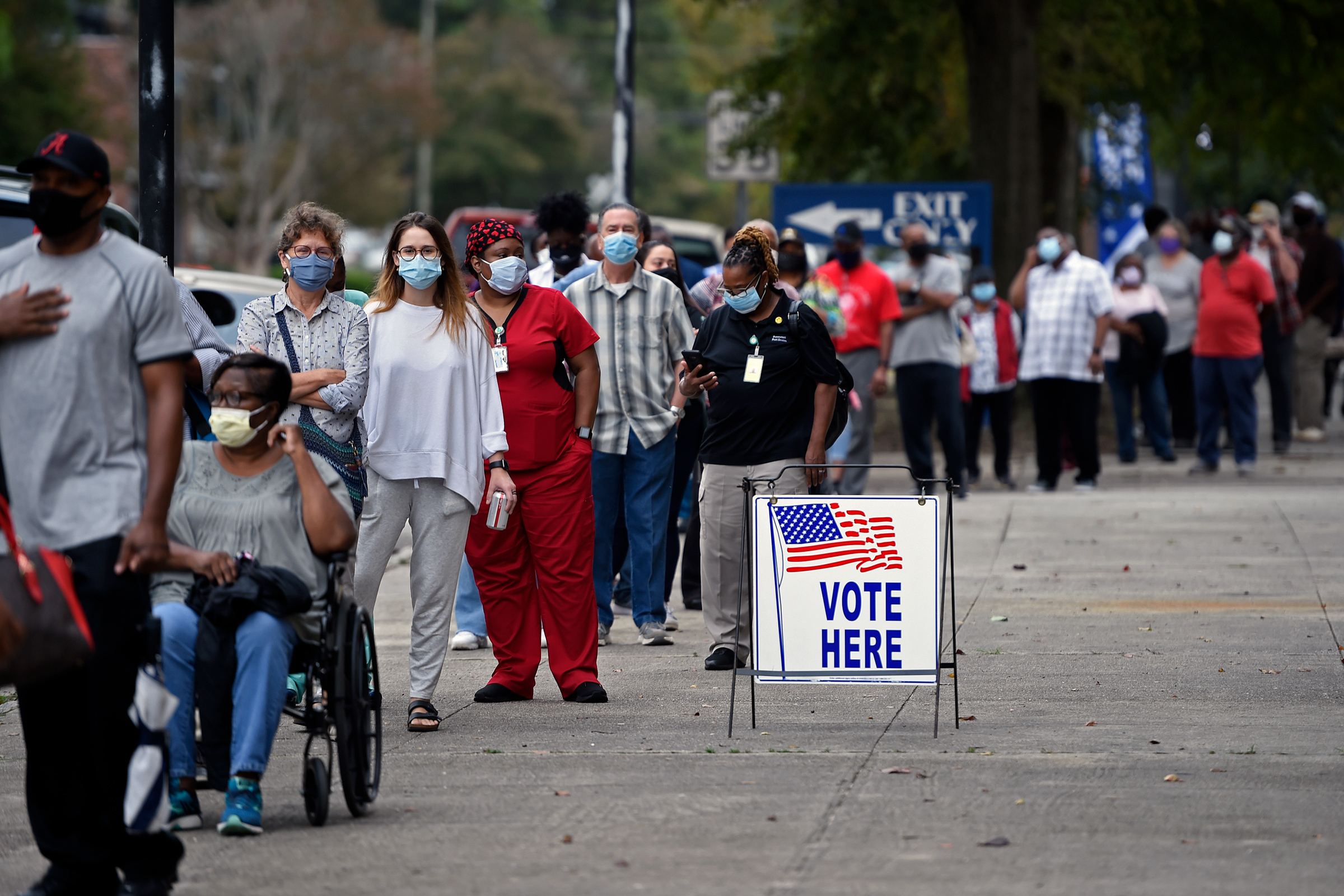 People wait in line for early voting at the Bell Auditorium in Augusta, Ga on Oct. 12, 2020.