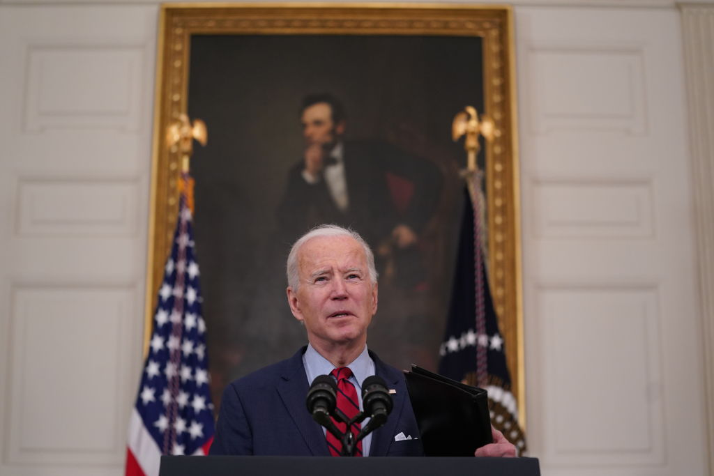 U.S. President Joe Biden speaks in the State Dining Room of the White House in Washington, D.C., on Tuesday, March 23, 2021, one day after a shooter killed 10 people in a supermarket in Colorado.
