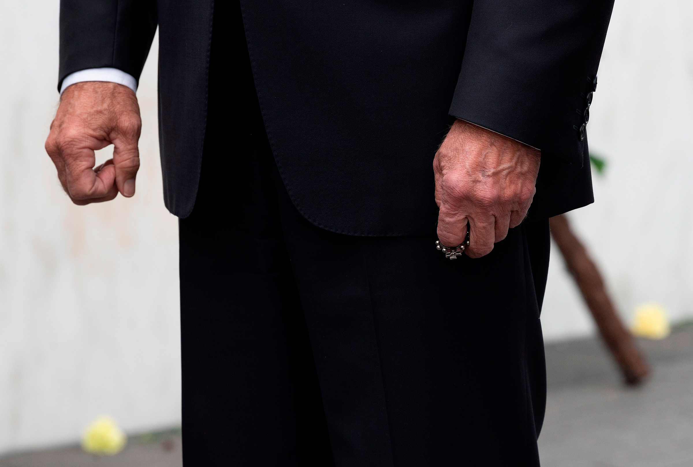 Biden clutches a rosary after laying a wreath on Sept. 11, 2020, at the Flight 93 National Memorial, near Shanksville, Pa.