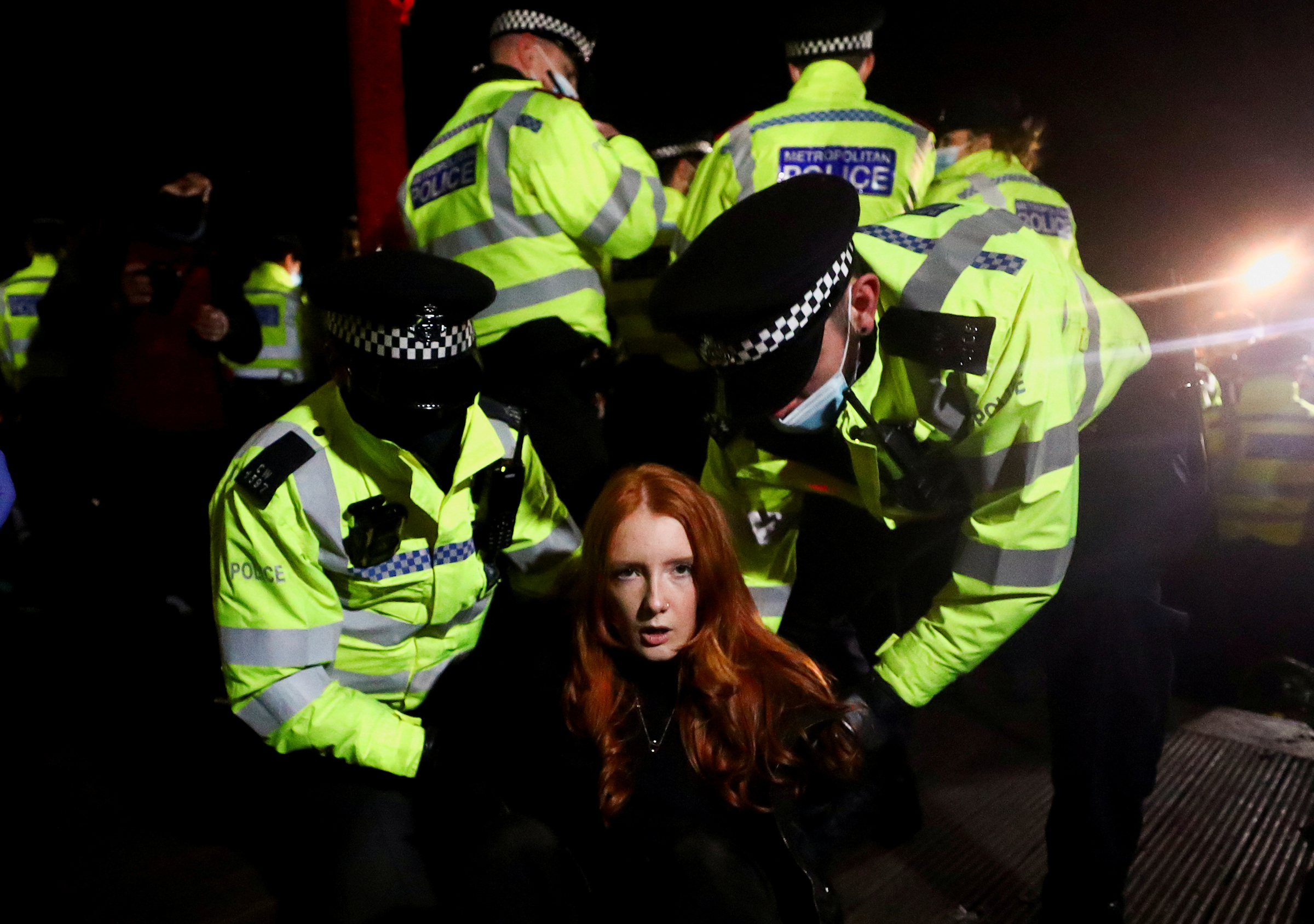 Police detain Patsy Stevenson as people gather at a memorial site in Clapham Common Bandstand, following the kidnap and murder of Sarah Everard, in London on March 13