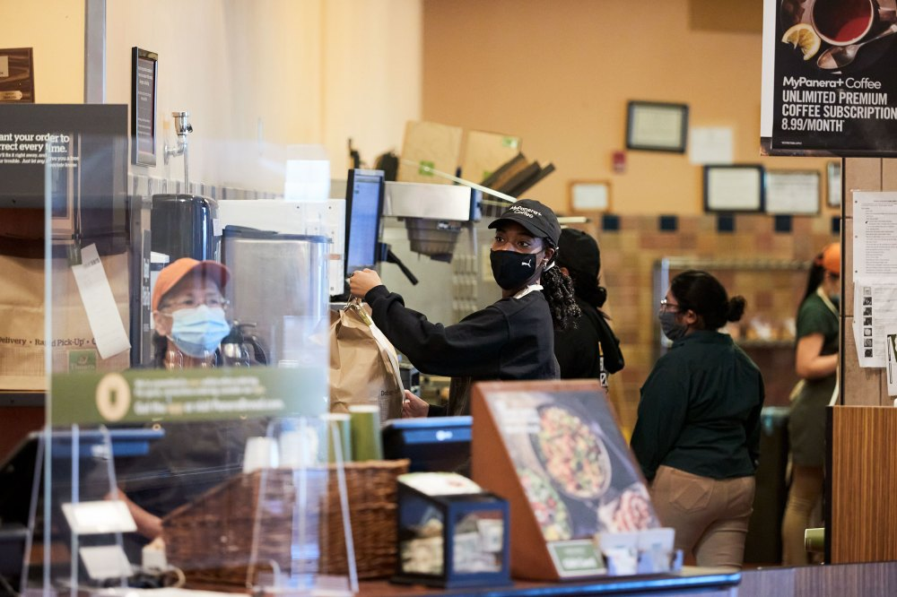 Joseph readies a takeout order at Panera Bread café in Bay Shore, N.Y.