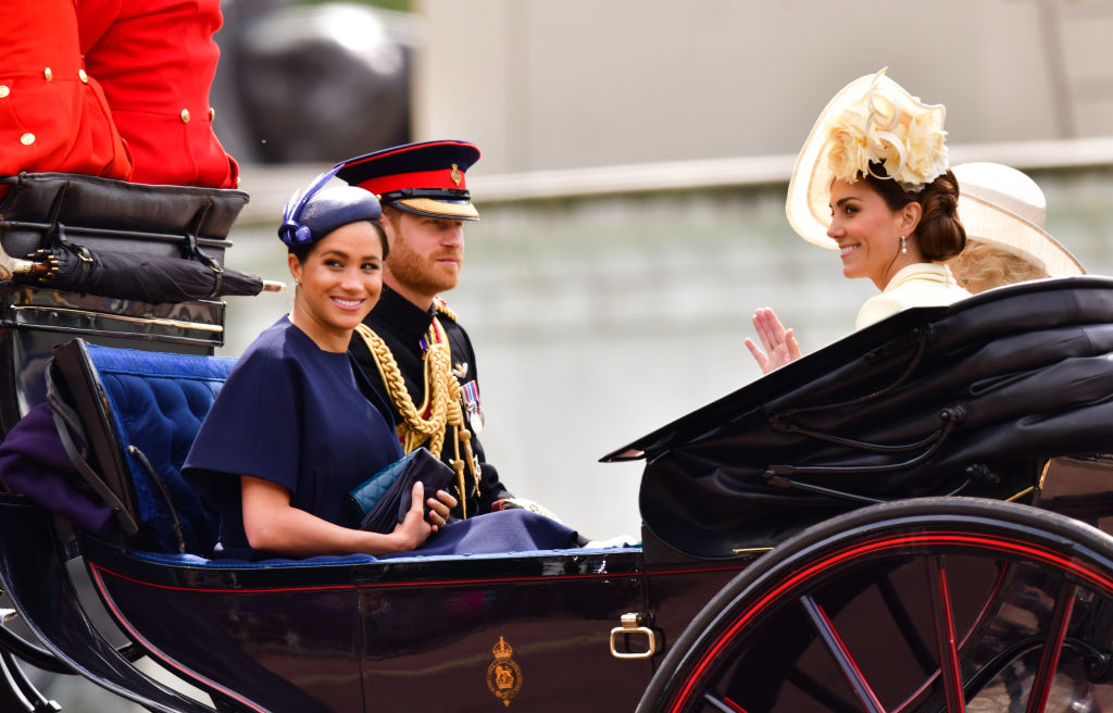 Meghan, Duchess of Sussex, Prince Harry, Duke of Sussex and Catherine, Duchess of Cambridge leave Buckingham Palace in a carriage during Trooping The Colour, the Queen's annual birthday parade, on June 8, 2019 in London, England.