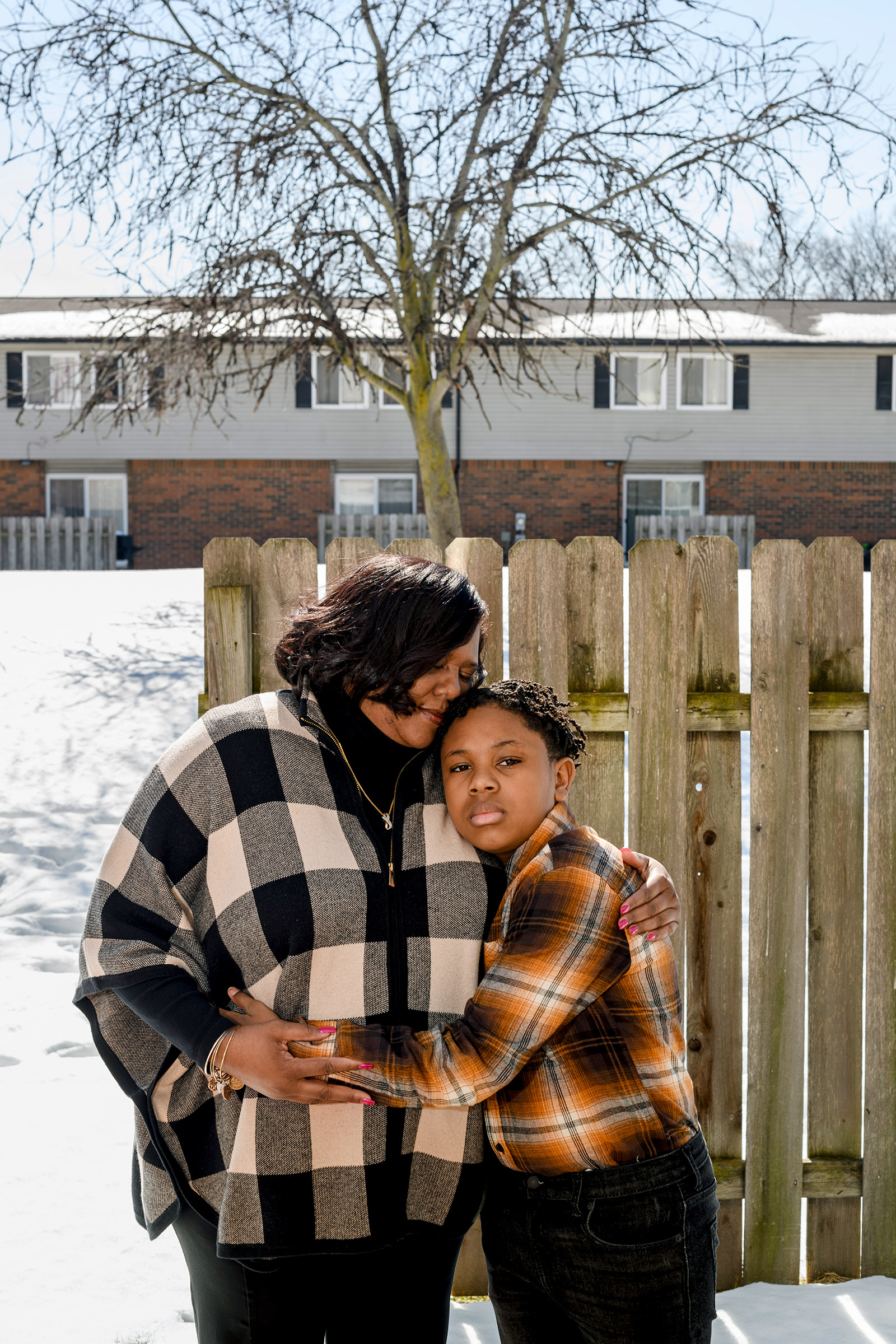 Tamara Brown and her son near their home in Southfield, Mich.