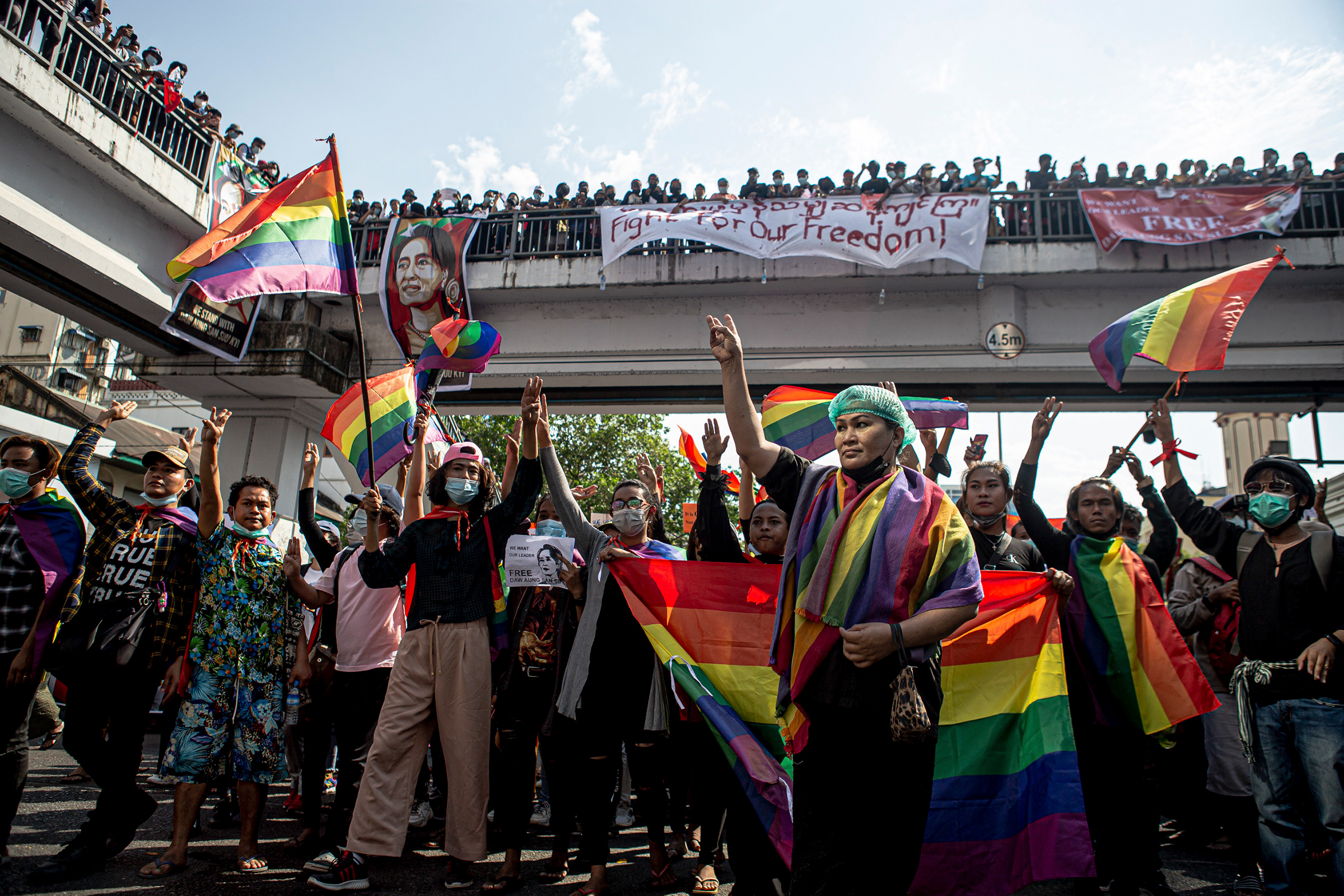 Members of the LGBTQ+ community flash pride flags and take part in protests against the military coup on Feb. 8 in Yangon, Myanmar.