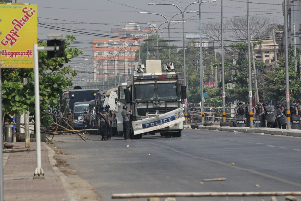 Security forces intervene in protesters as they gather to protest against the military coup in Mandalay, Myanmar on February 28, 2021.