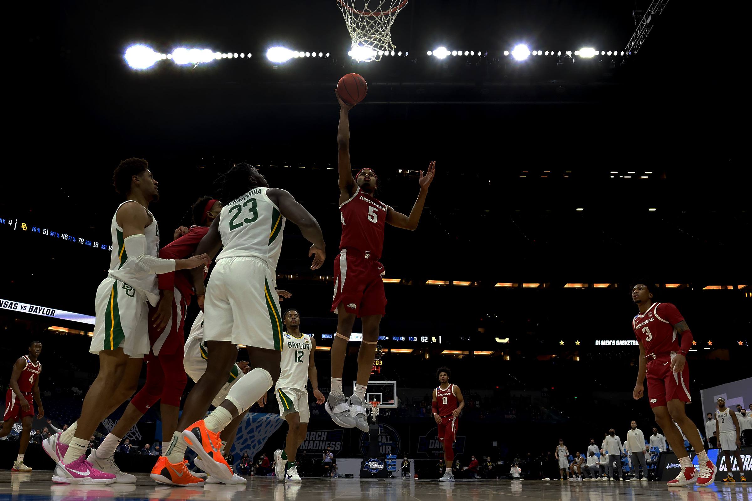 Moses Moody #5 of the Arkansas Razorbacks scores against the Baylor Bears in the Elite Eight round of the 2021 NCAA Division I Men's Basketball Tournament held at Lucas Oil Stadium on March 29, 2021 in Indianapolis, Indiana.